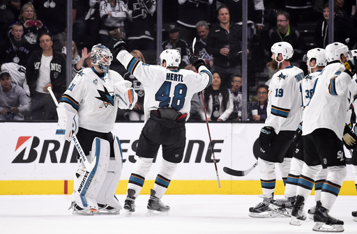 Sharks blow 3-goal lead, but rally to eliminate Kings 6-3