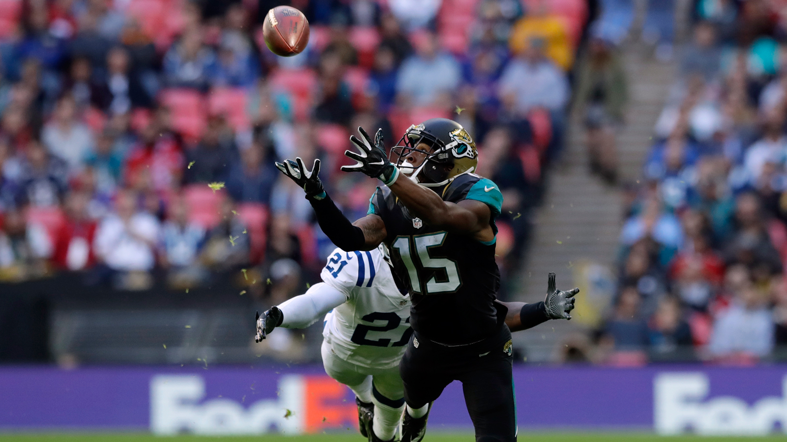 Jaguars withstand late rally, beat Colts in London for first victory