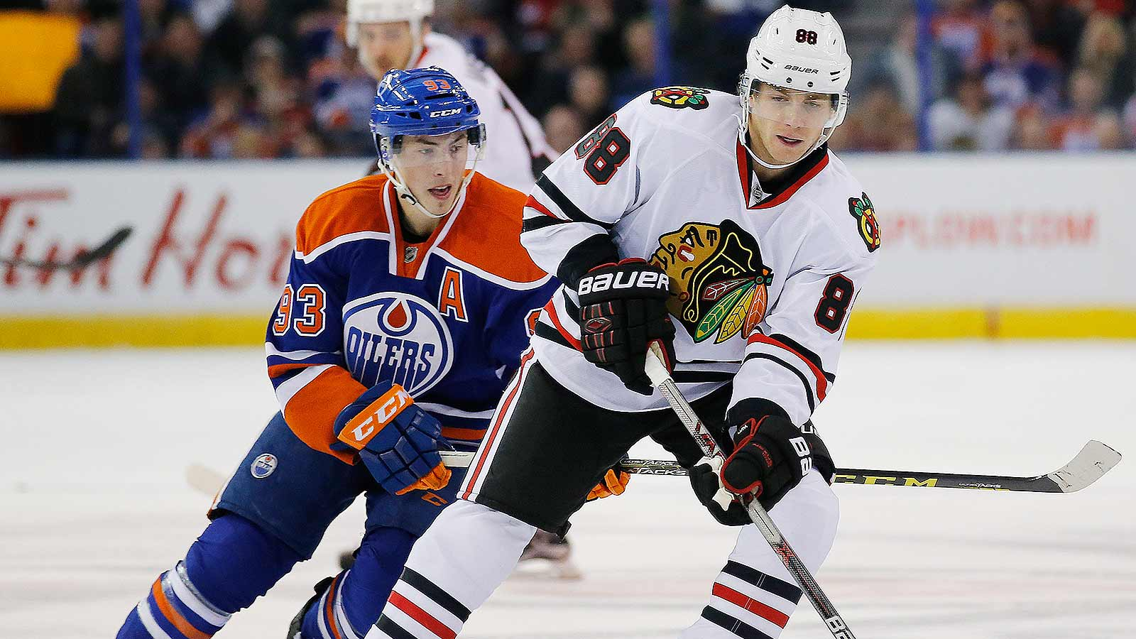 Kane extends point streak, Blackhawks outlast Oilers in OT