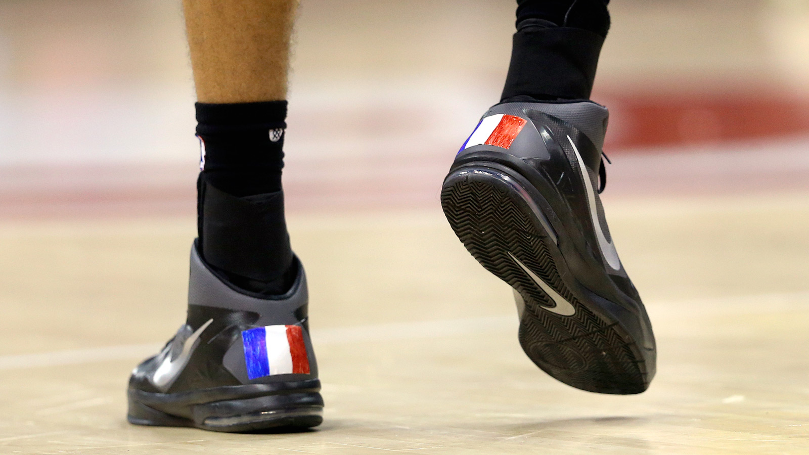 Gobert wears native France on his shoes, then helps Jazz past Hawks