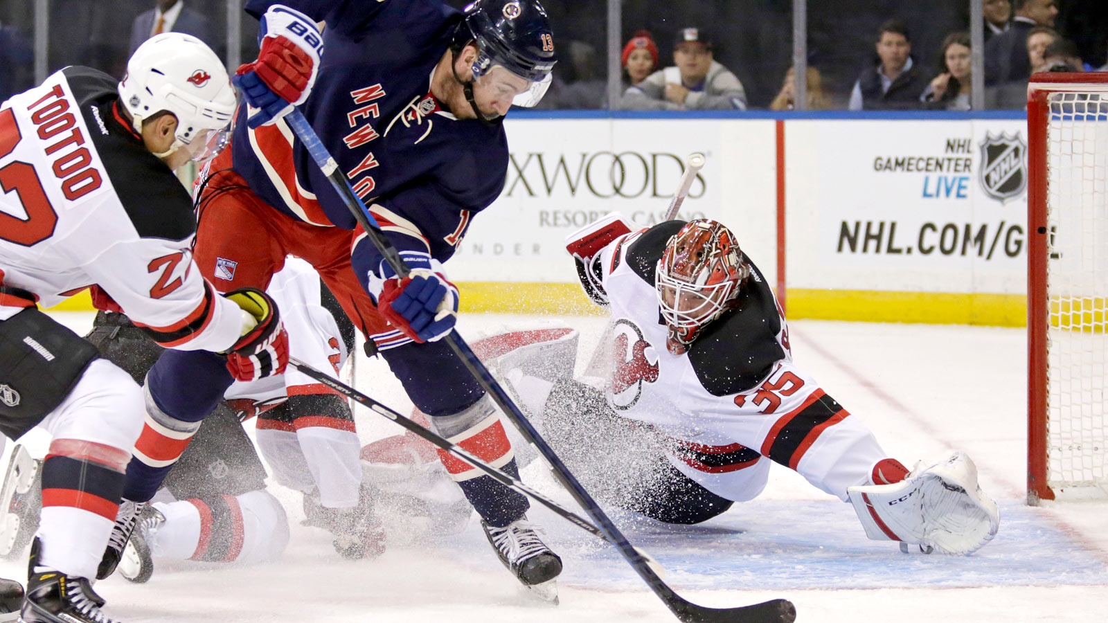 Devils win in overtime, hand Rangers third straight loss