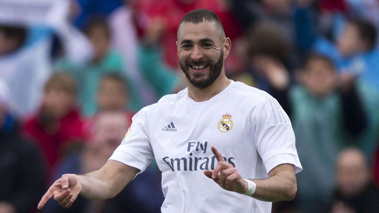 Real Madrid down Getafe to keep heat on Barca, Atletico