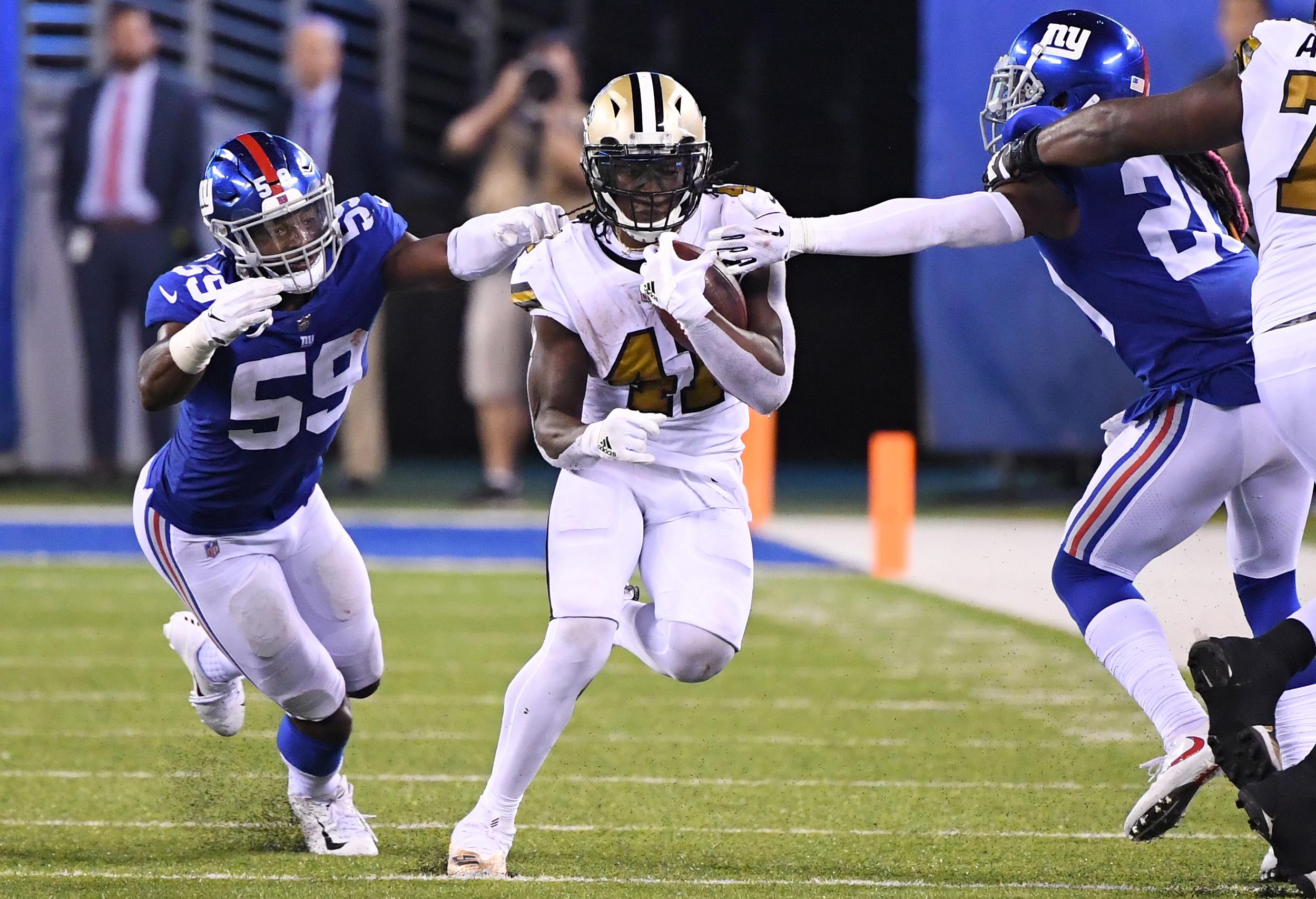 Kamara runs for 3 second-half TDs, Saints beat Giants 33-18