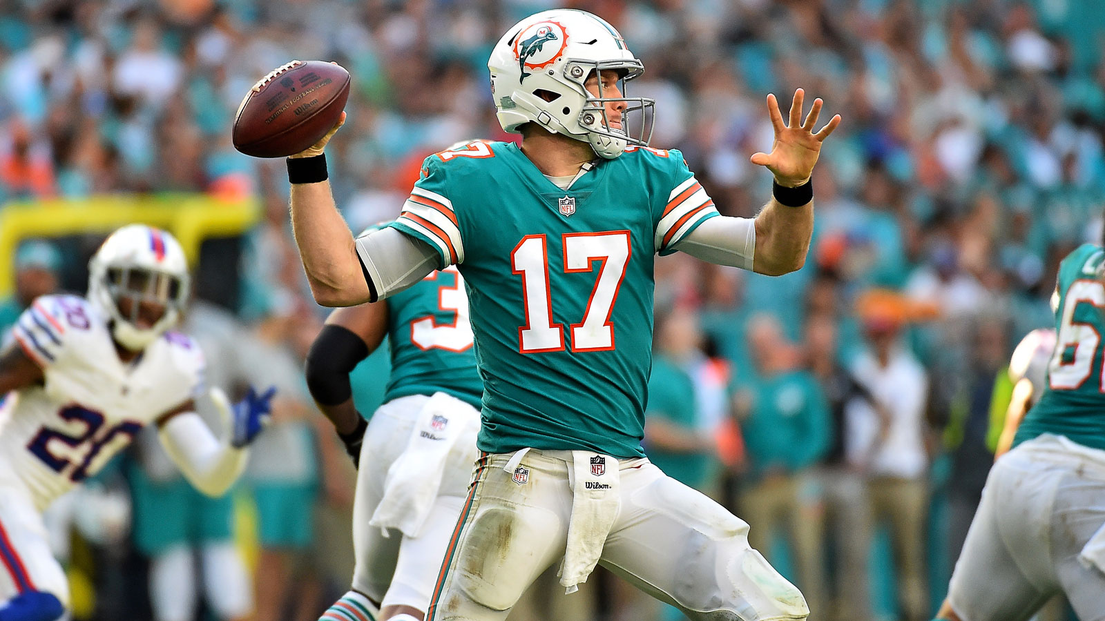 Ryan Tannehill's 3 TDs help Dolphins keep playoff hopes alive with win over Bills