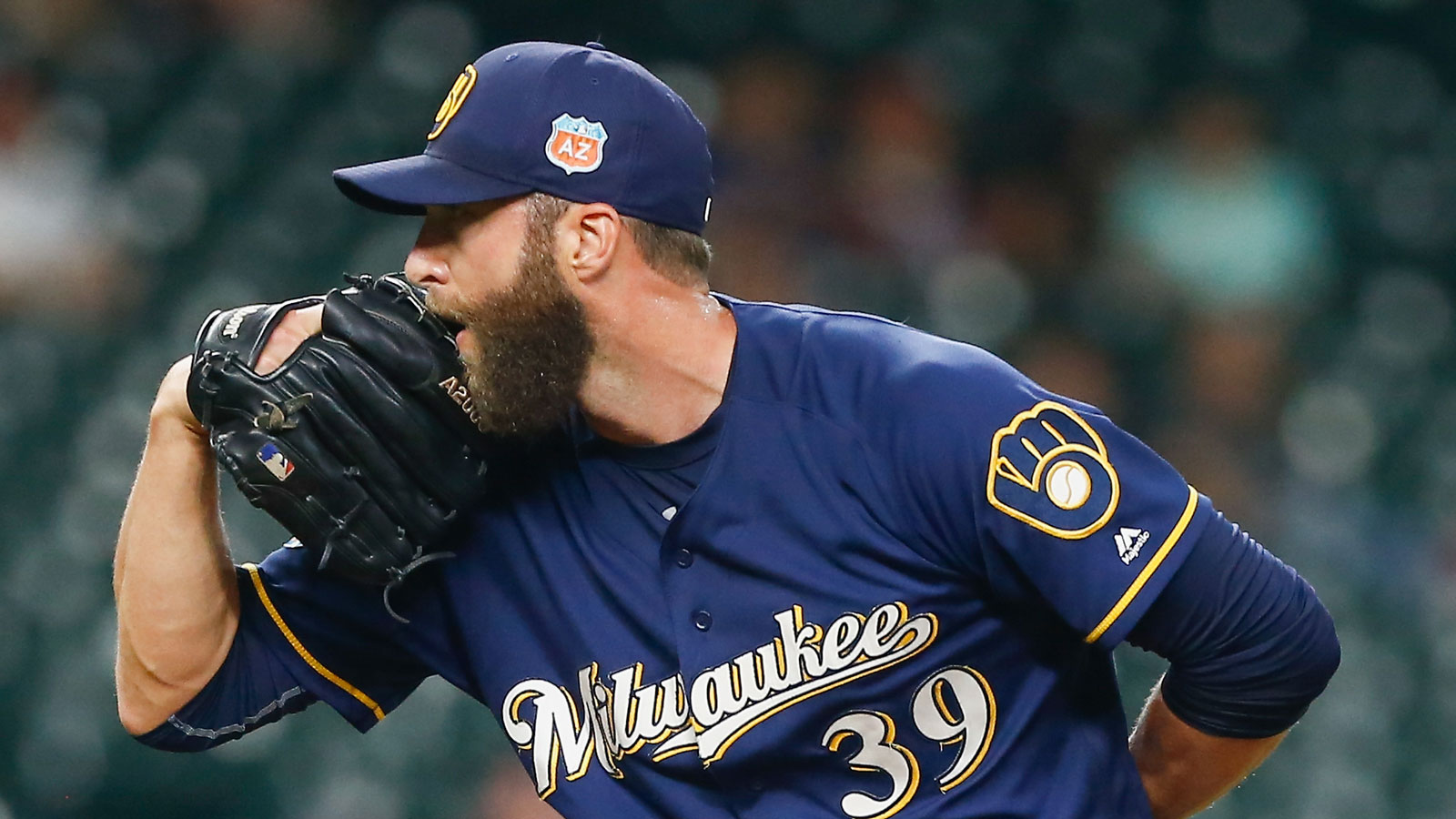 Brewers shuffle relievers on opening-day roster