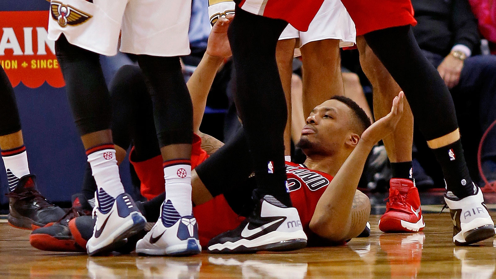 Dame Lillard clotheslined by Kendrick Perkins, shakes it off: 'I'm from Oakland'