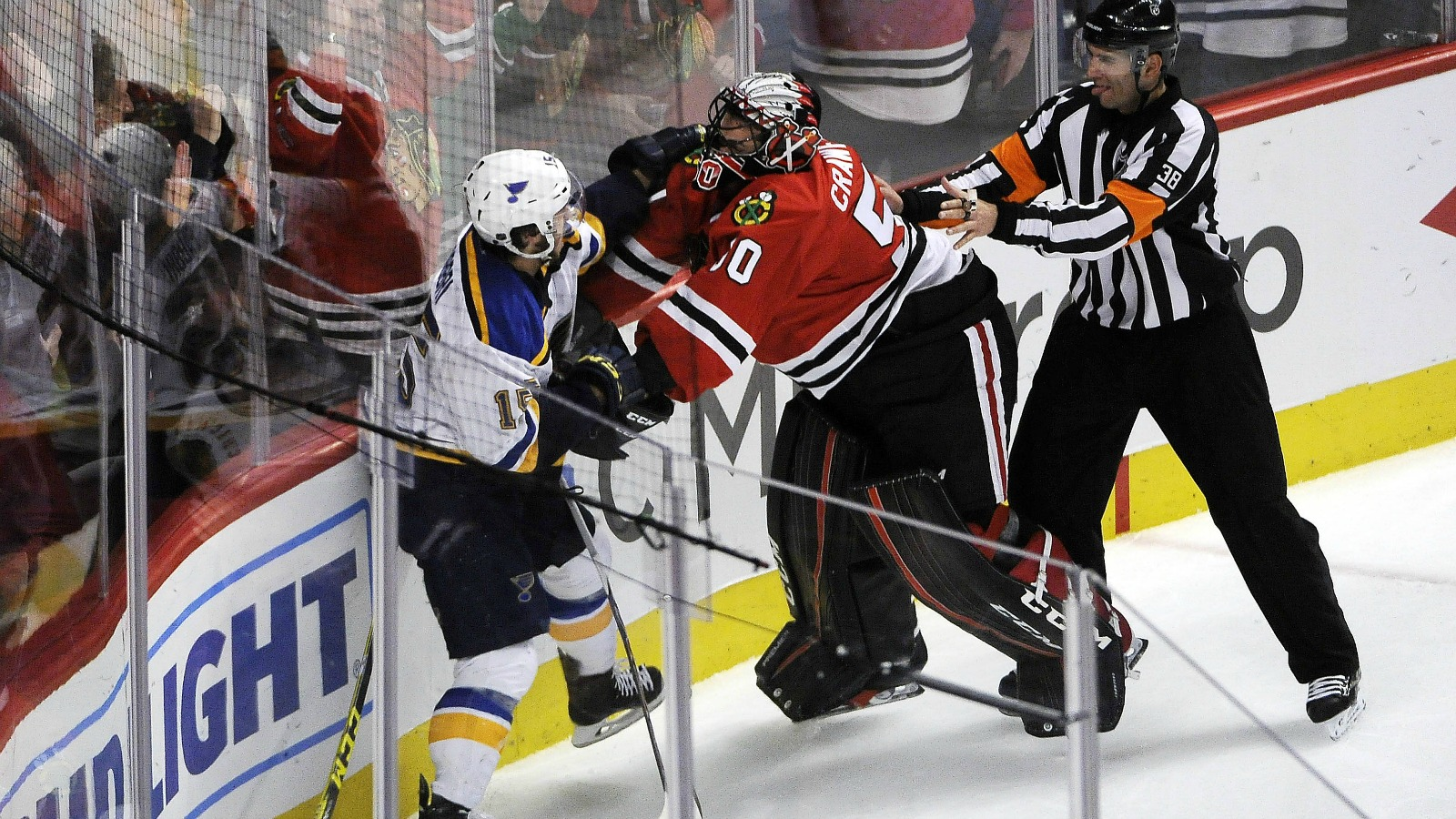 Blackhawks goalie Corey Crawford starts a brawl after collision at net