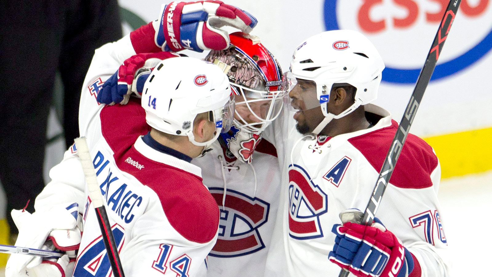 Condon stars in NHL debut, keeps Canadiens perfect through three games