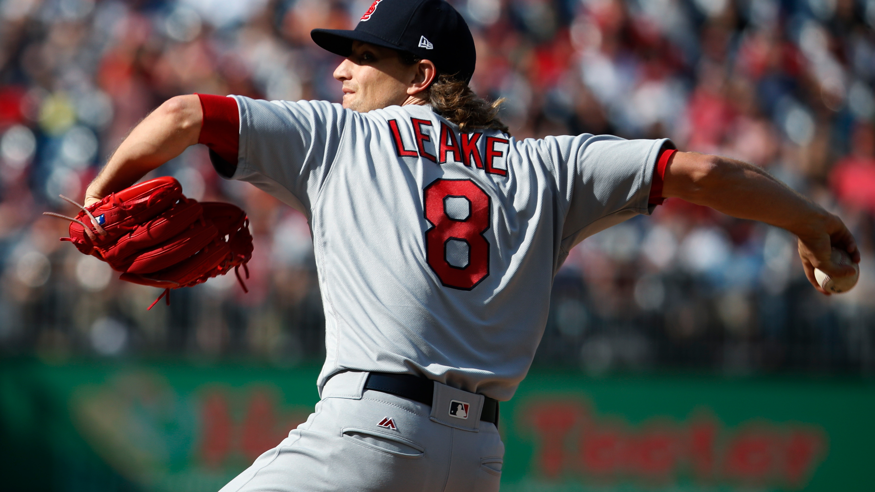 Leake's arm, Piscotty's bat lift Cards over Nats 6-1