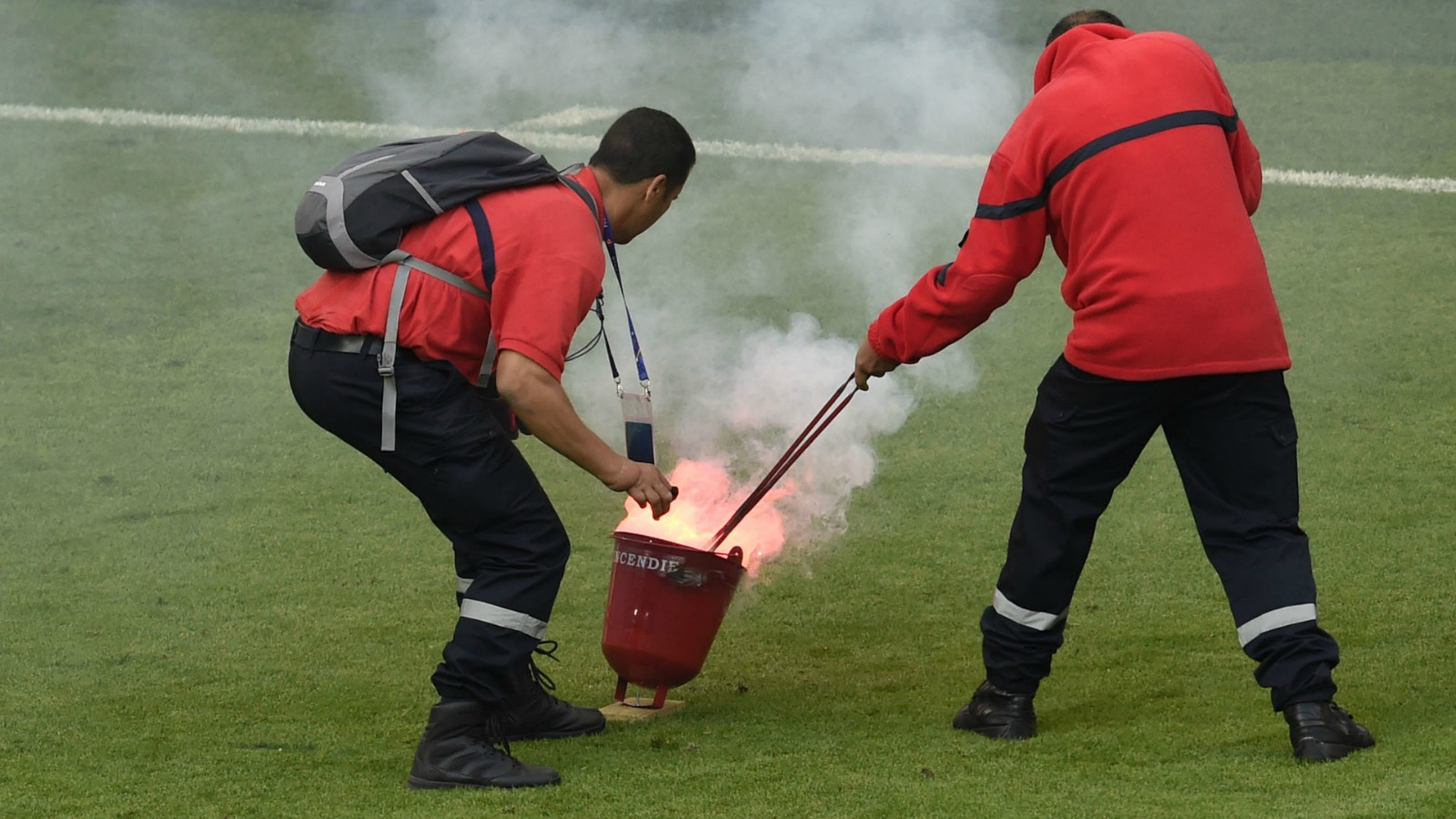 Fans throw flares, explosive on pitch at Euro 2016