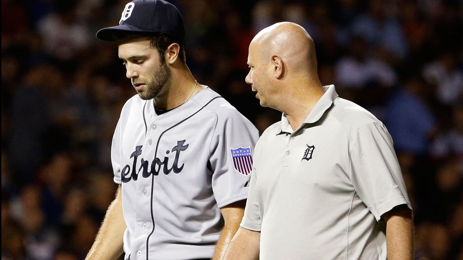 Norris homers, suffers injury; Tigers pound Cubs 15-8