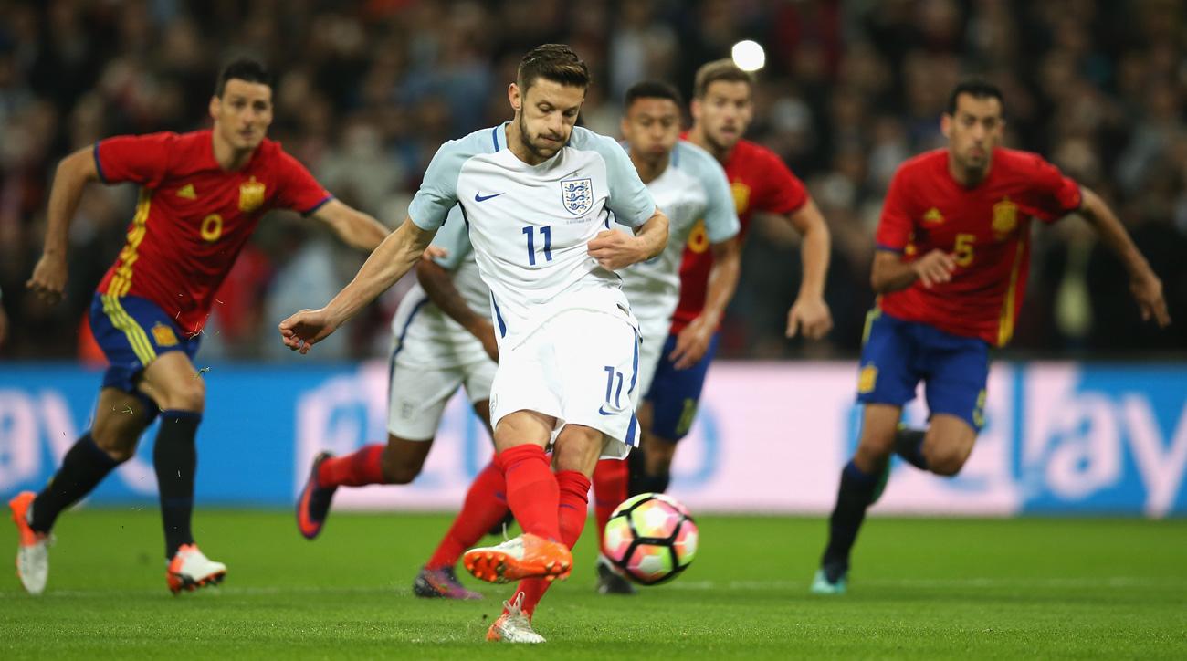 Watch: England leads Spain on early Adam Lallana penalty