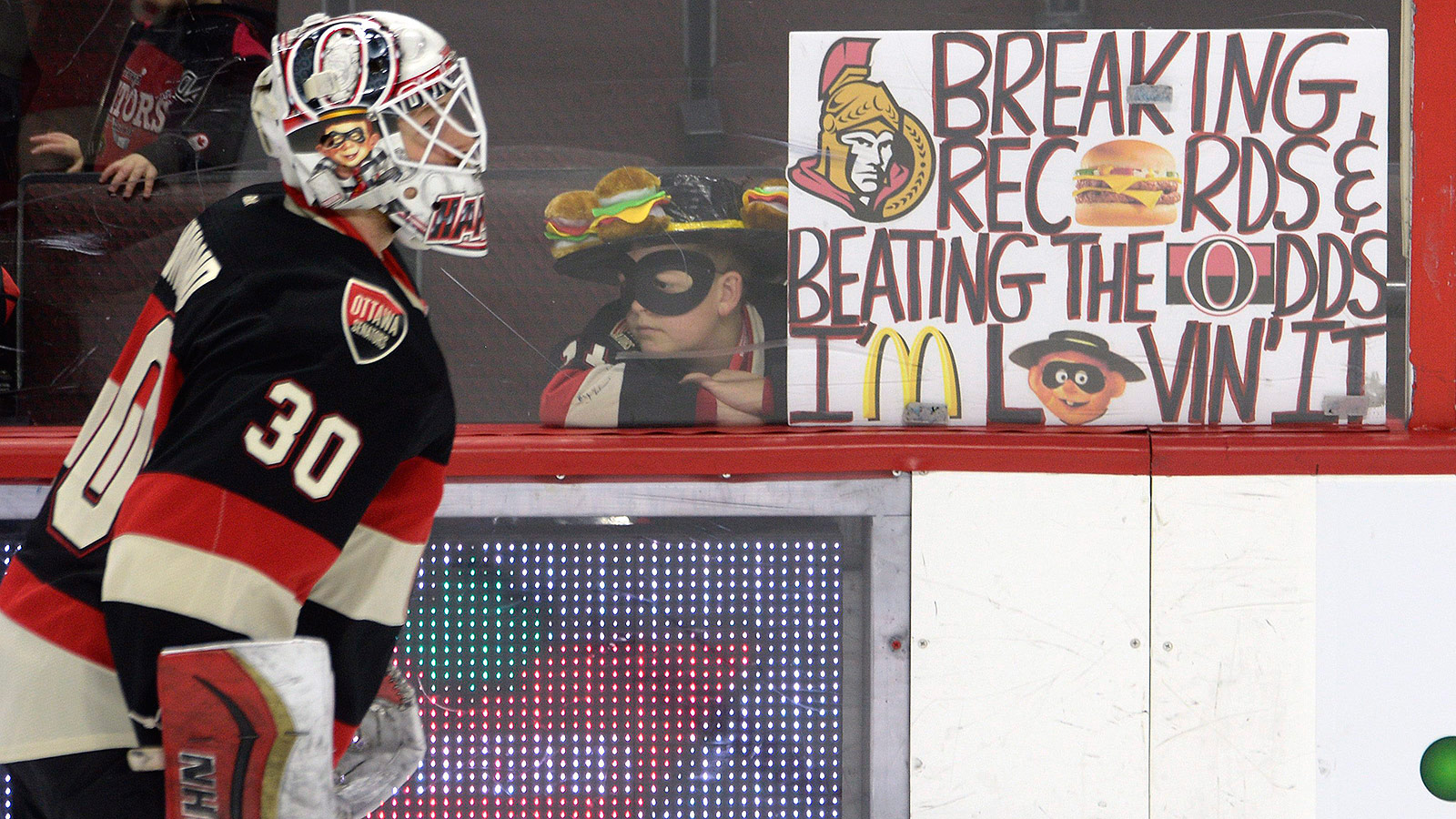 Fans toss burgers at goalie again, only this time one gets eaten