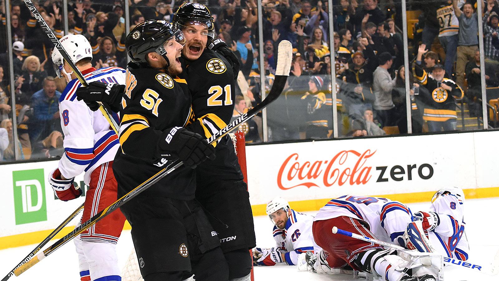 Bruins rally to beat Rangers, extend winning streak