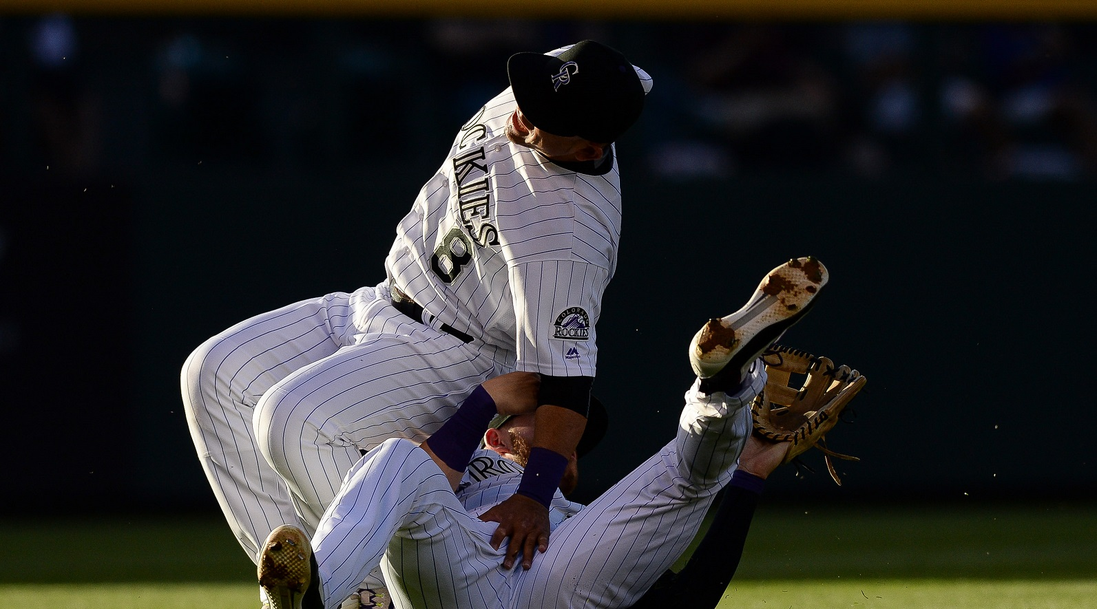Gerardo Parra suffers scary leg injury after Trevor Story dives into him