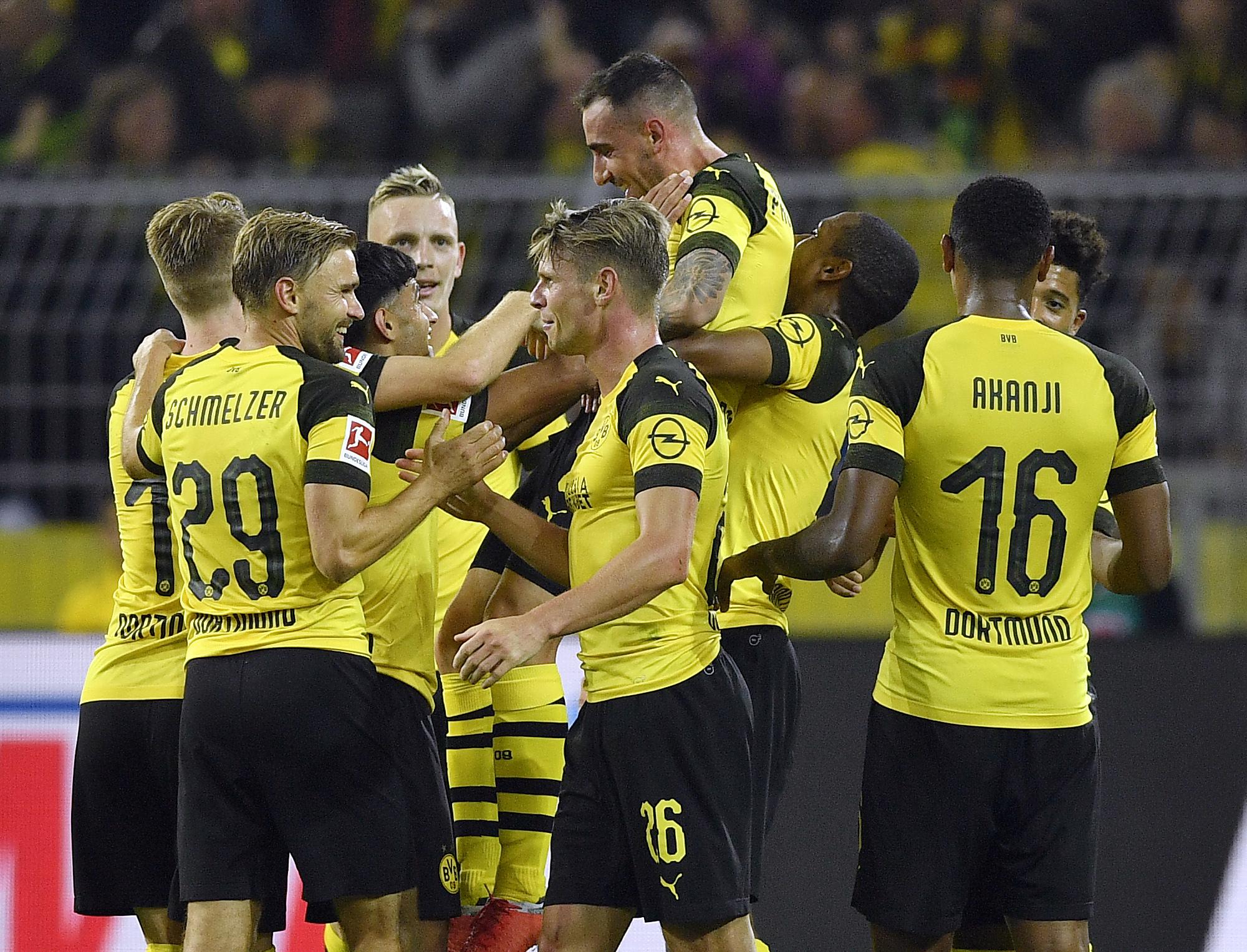 Alcacer stars in debut, seals Dortmund's 3-1 win in Germany