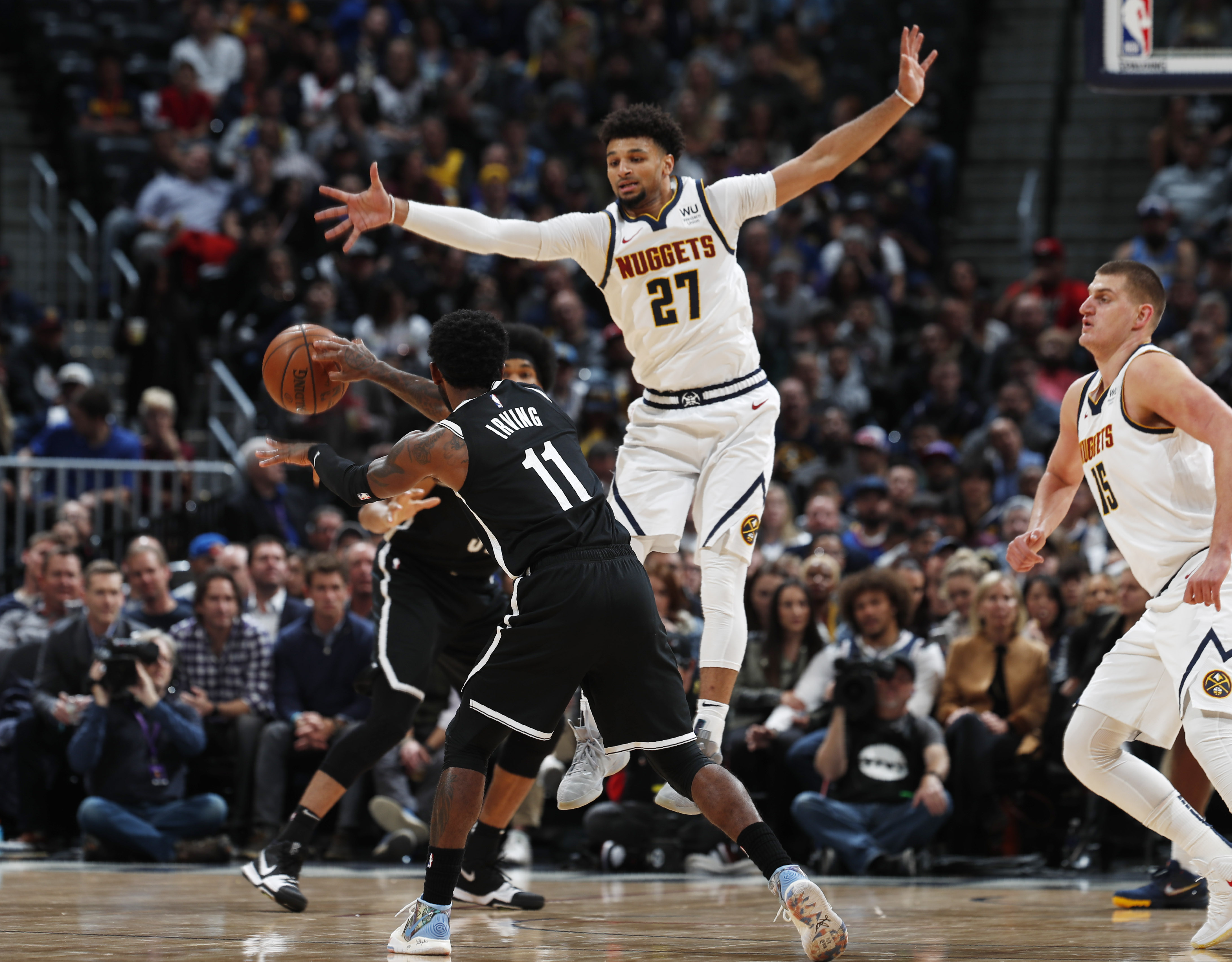Plumlee, bench help Nuggets rally past Nets 101-93