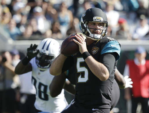 Titans sputter, lose Mariota, fall to inspired Jaguars 38-17
