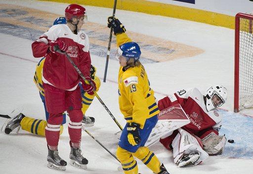 US tops Latvia 6-1 in its world junior opener