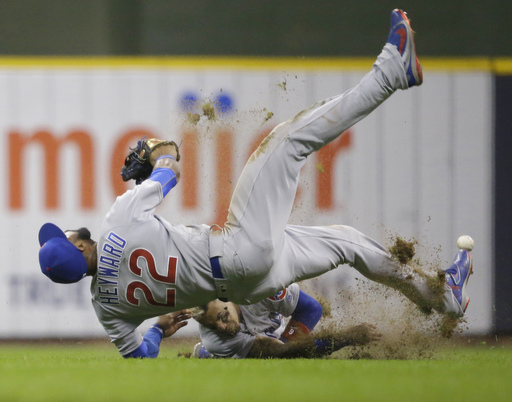 Cubs' Baez collides with Heyward year after Schwarber injury