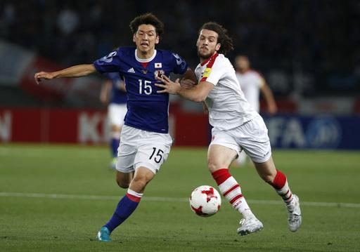 Japan draws 1-1 with Syria but loses Kagawa to injury