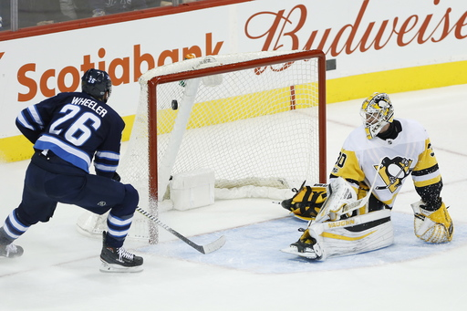 Wheeler scores 3 of Jets' 5 goals in 1st to rout Pens 7-1