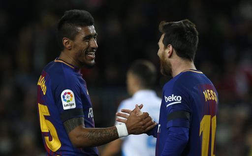 Messi misses penalty as Barca wins big to increase lead