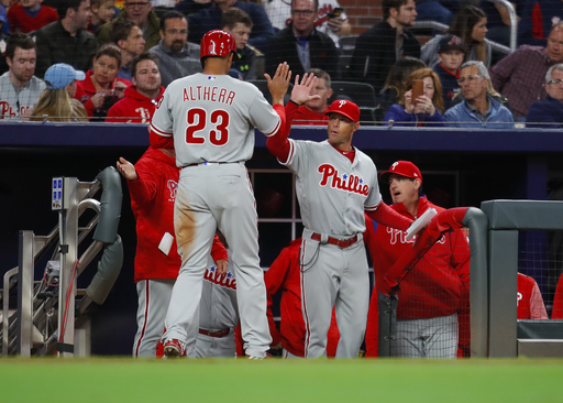Santana's sac fly gives Phillies 5-4 win over Braves in 11th
