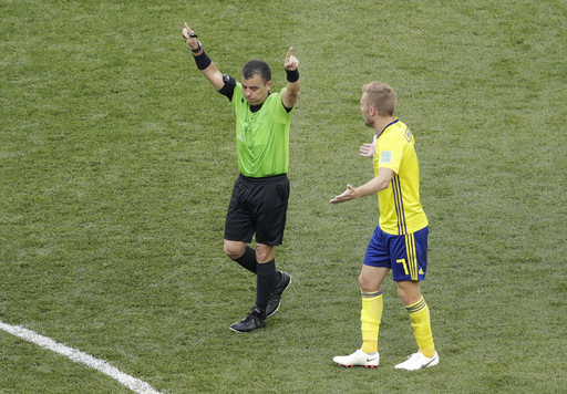 The Latest: FIFA 'extremely satisfied' with referee standard