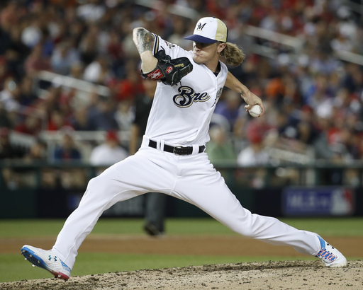 Hader challenged to 're-earn the trust' of Brewers teammates