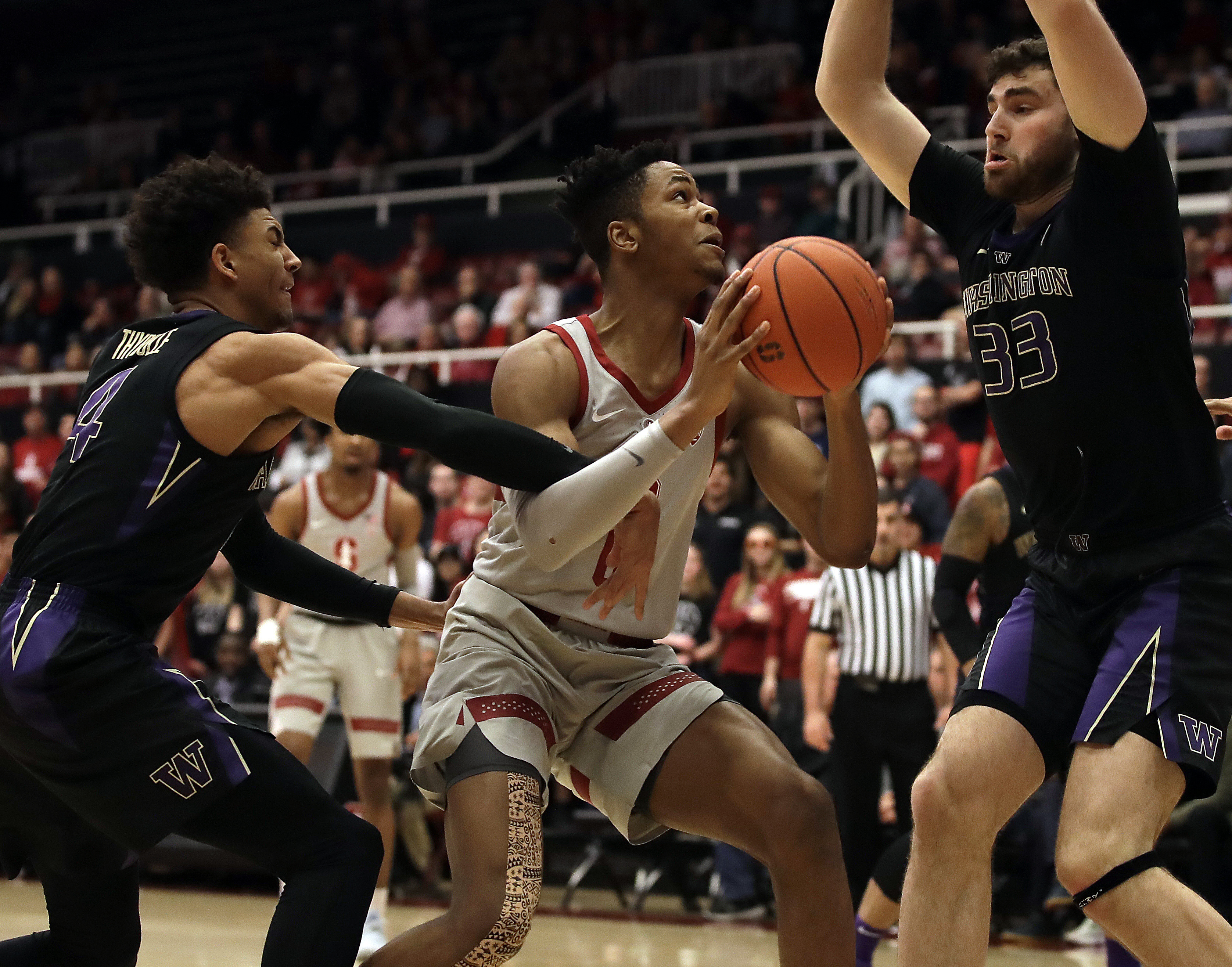 Nowell, No. 25 Washington hold off Stanford 62-61