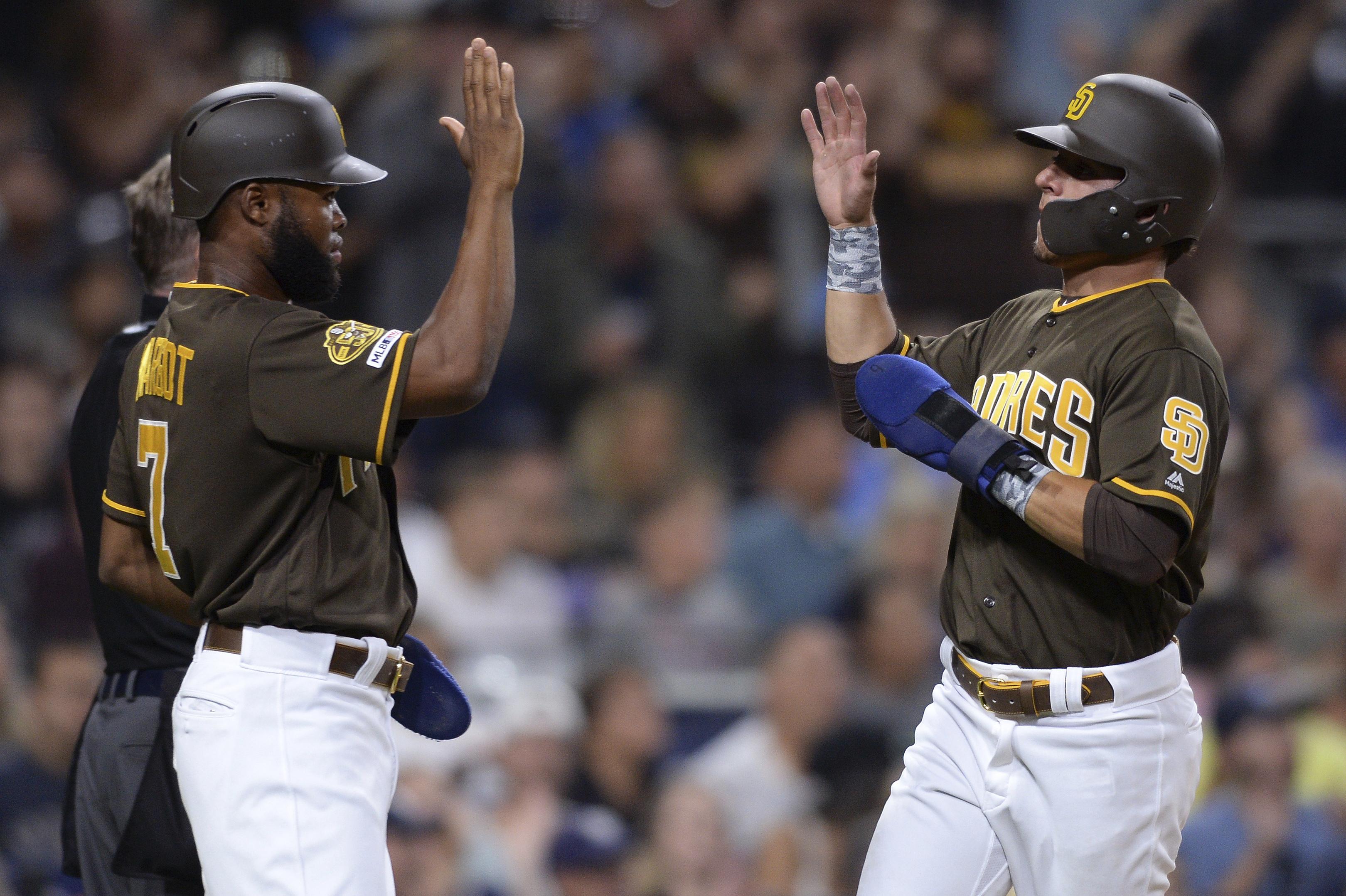 Rookies Tatis Jr., Quantrill lead Padres over Rockies 7-1