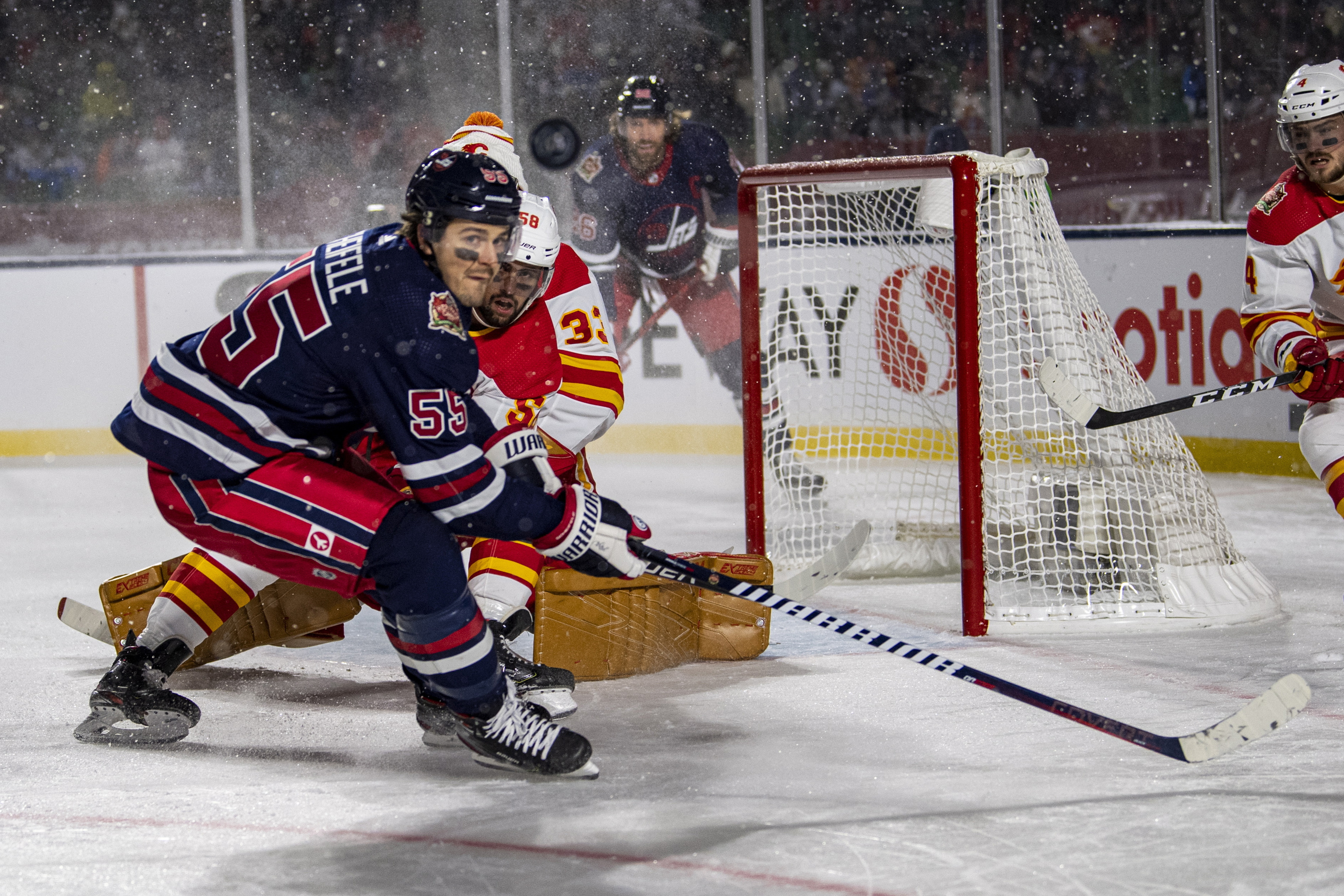 Little lifts Jets past Flames 2-1 in OT in Heritage Classic