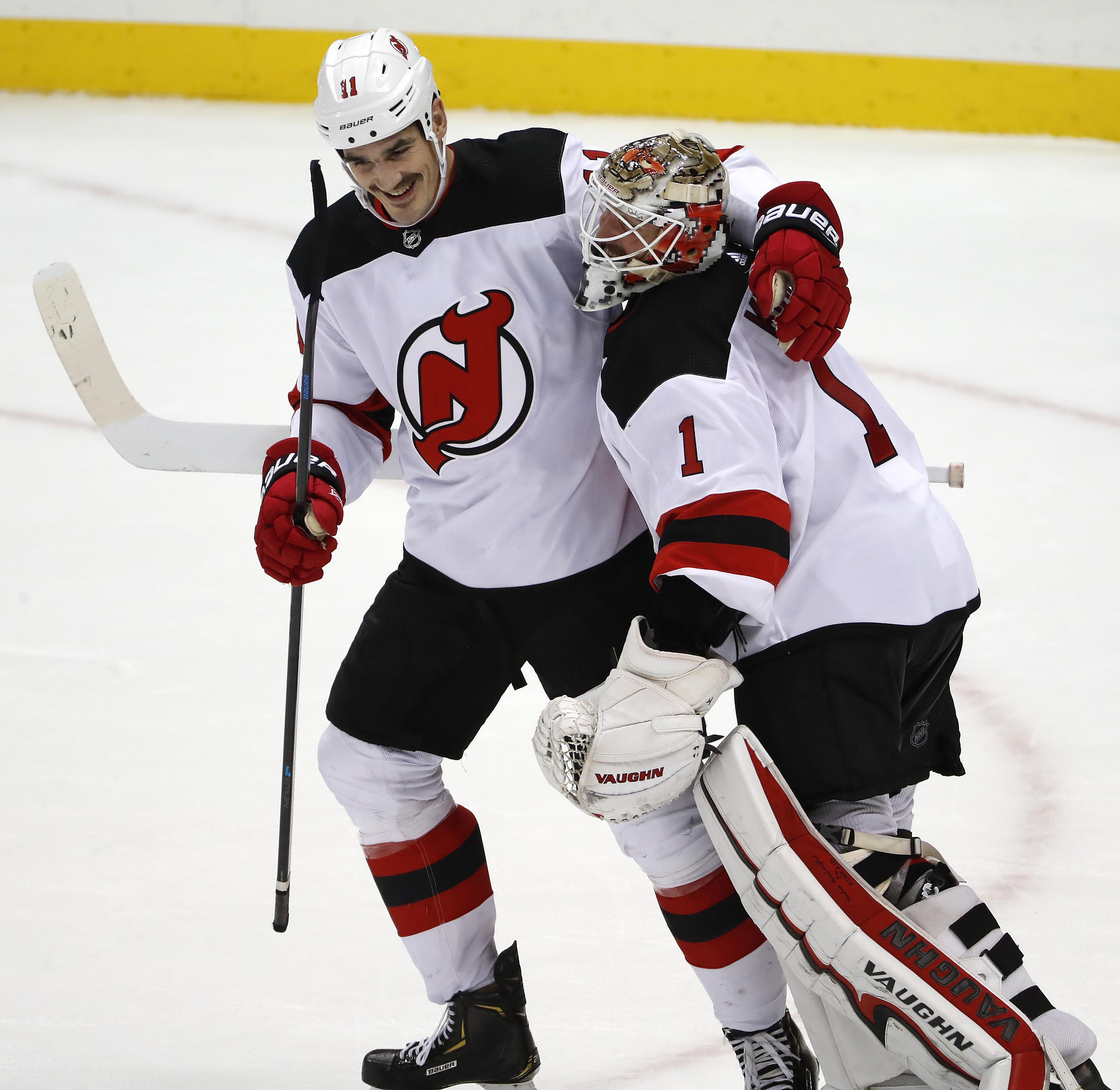 Boyle's hat trick helps Devils defeat Penguins