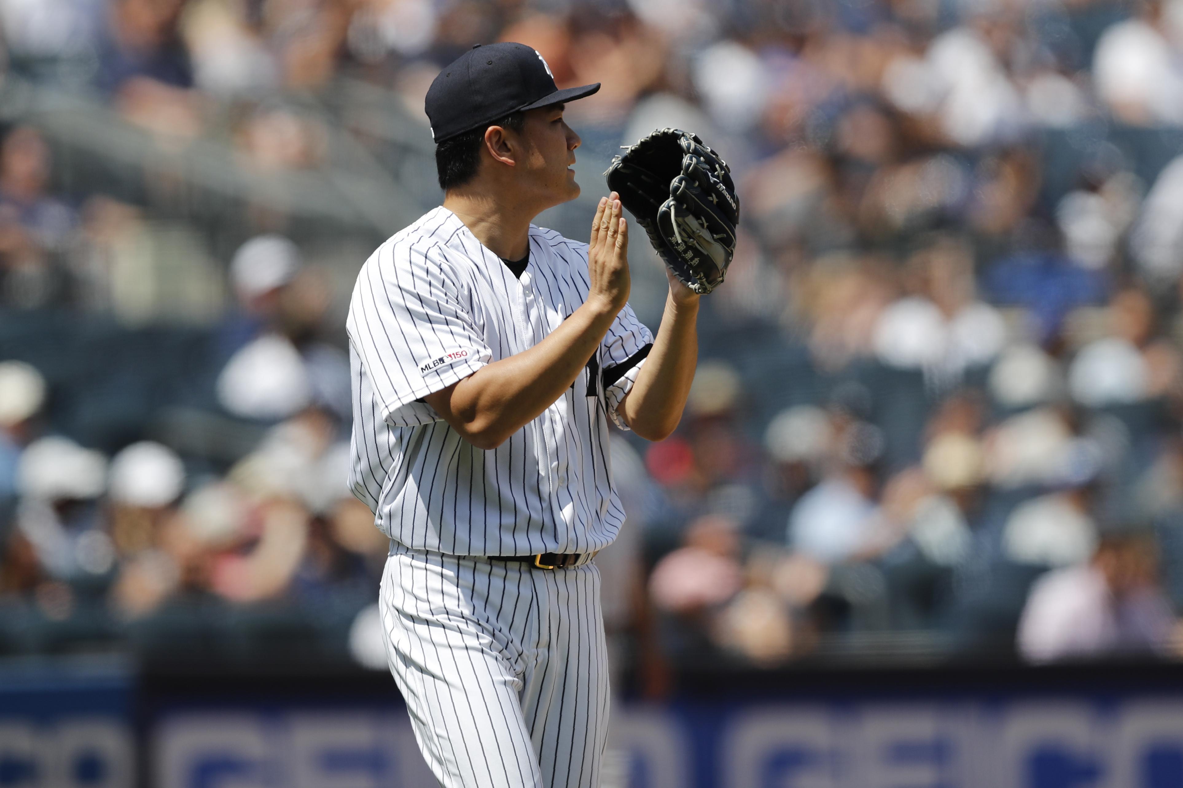 Tanaka helps Yankees earn 4-2 victory over Blue Jays