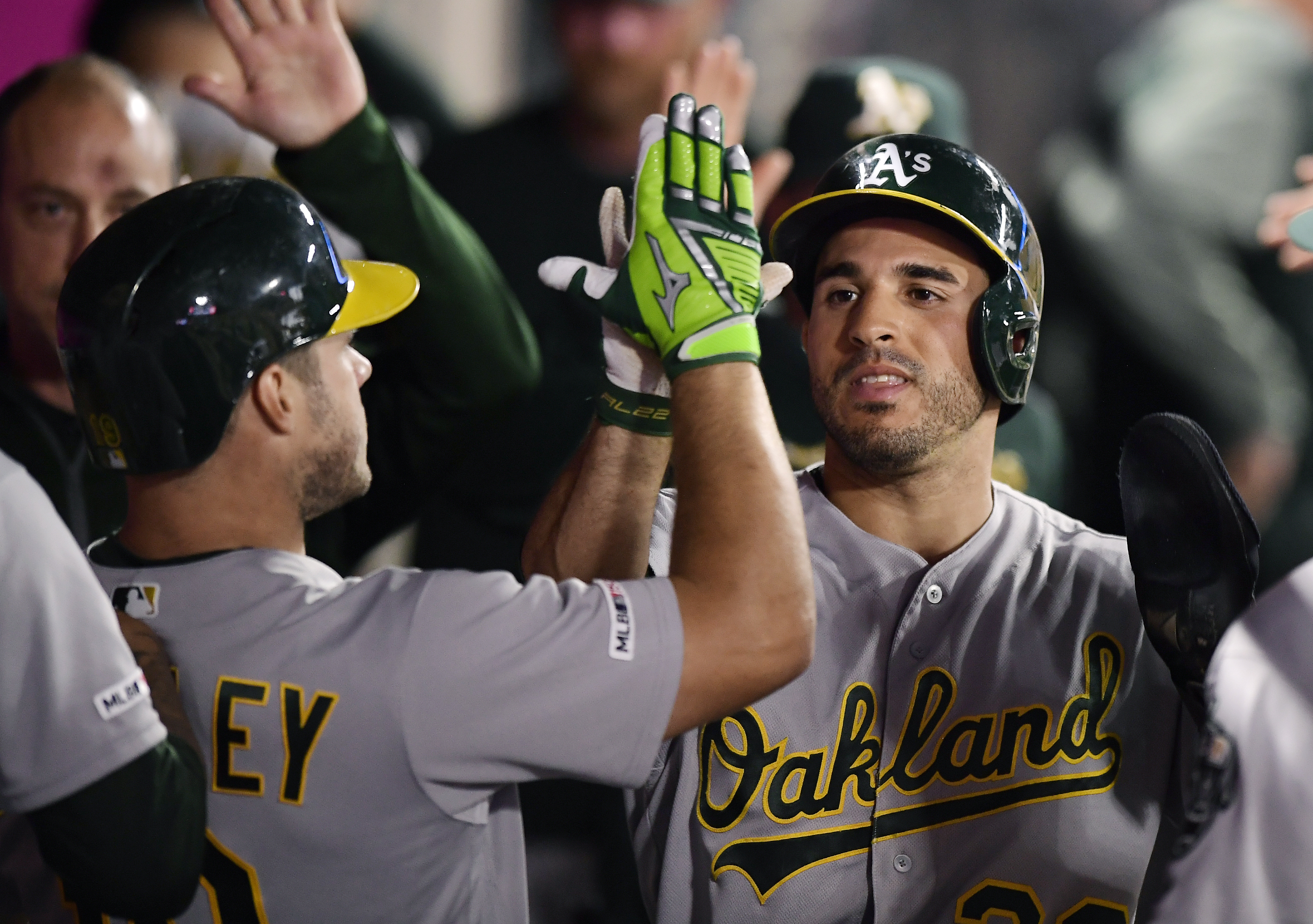Piscotty leads resourceful Athletics past Angels, 7-4