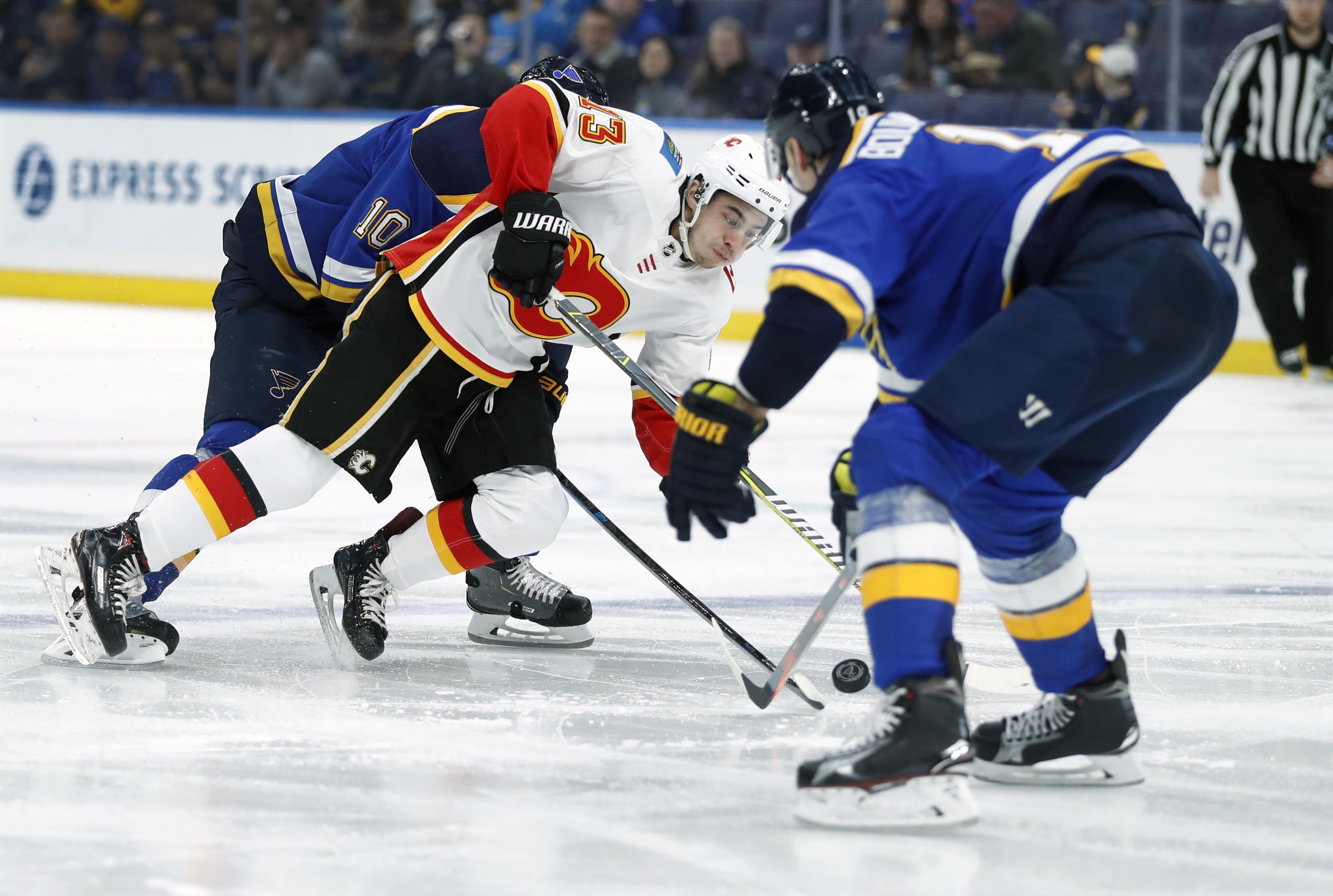 Gaudreau,  Quine score twice to lead Flames past Blues 7-2