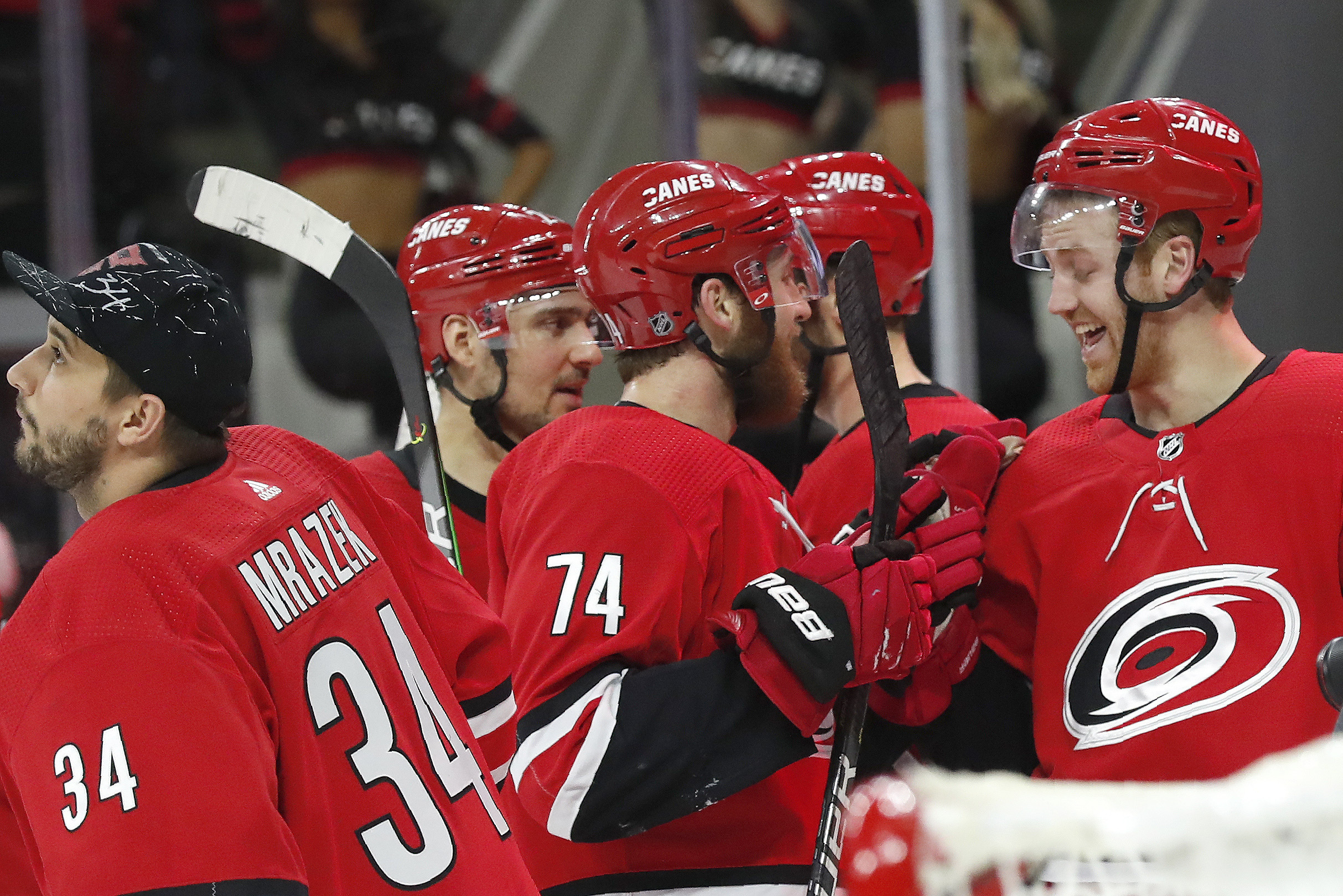 Hurricanes beat Flyers in OT, bring back Justin Williams