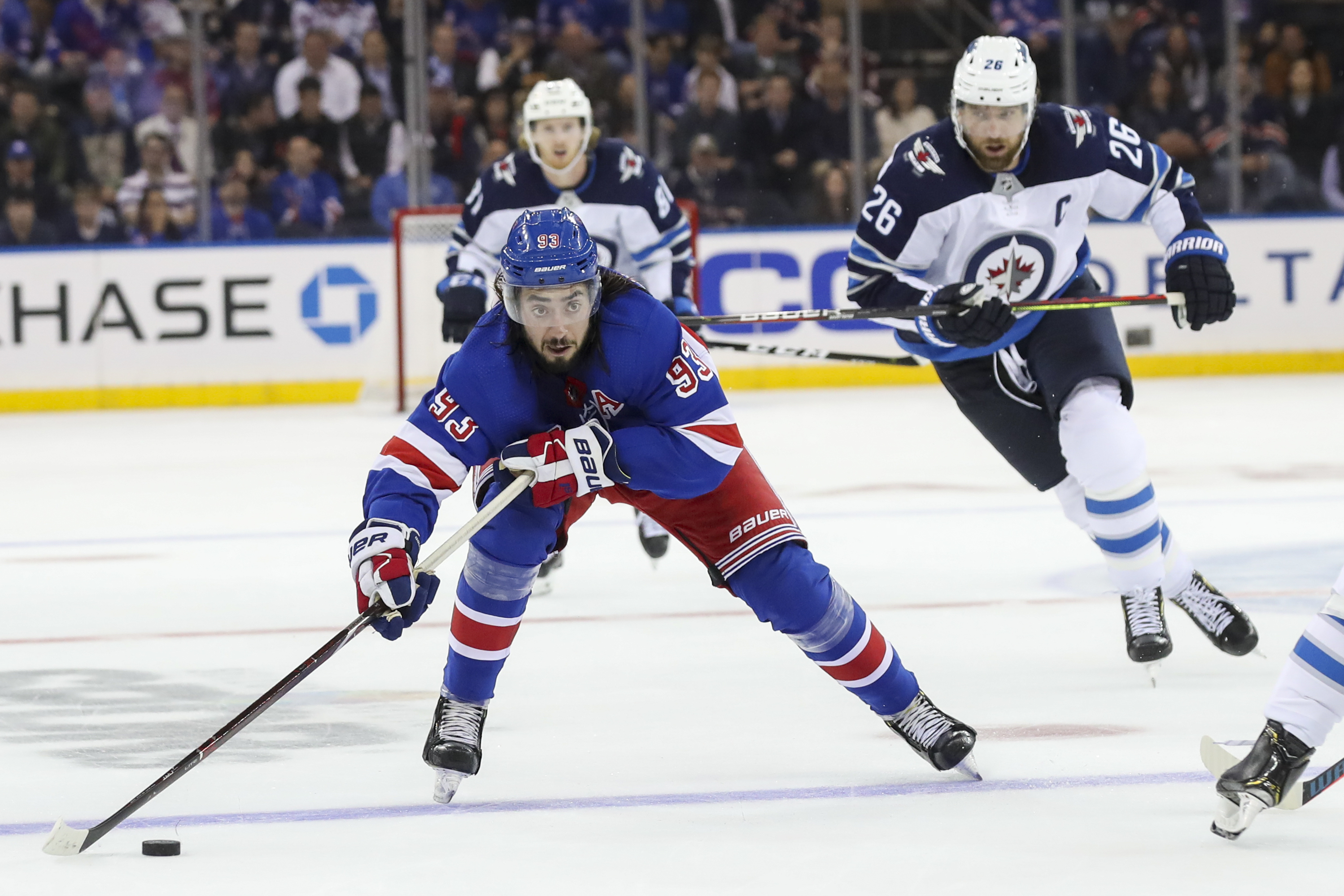 Howden scores late as Rangers beat Jets 6-4 in wild opener