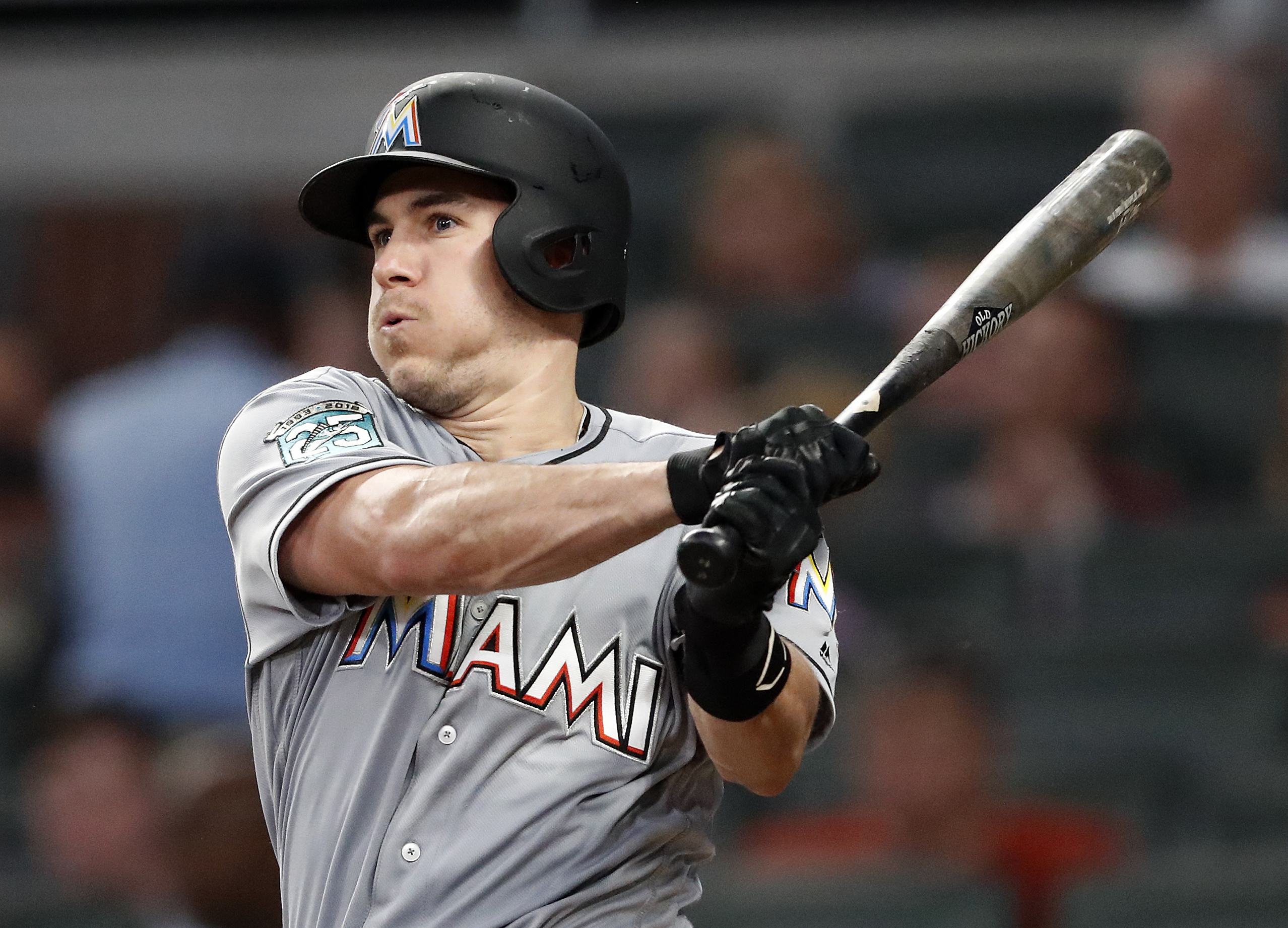 AP Source: Realmuto traded to Phillies for 3 players