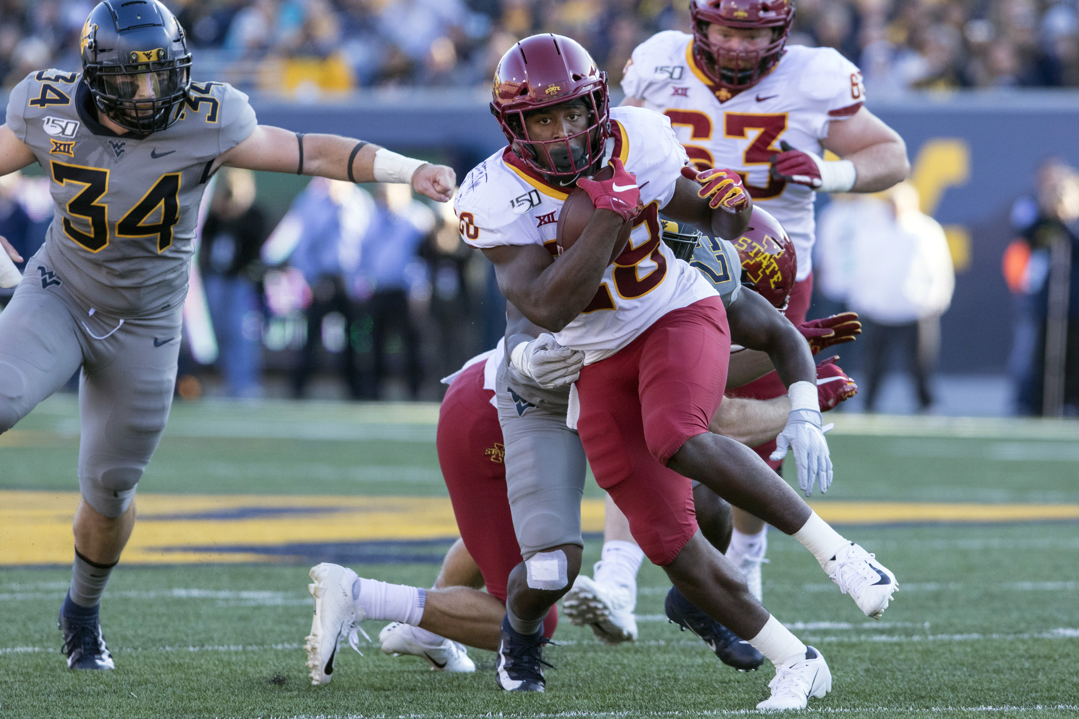 Frosh RB Hall leads Iowa State over West Virginia 38-14