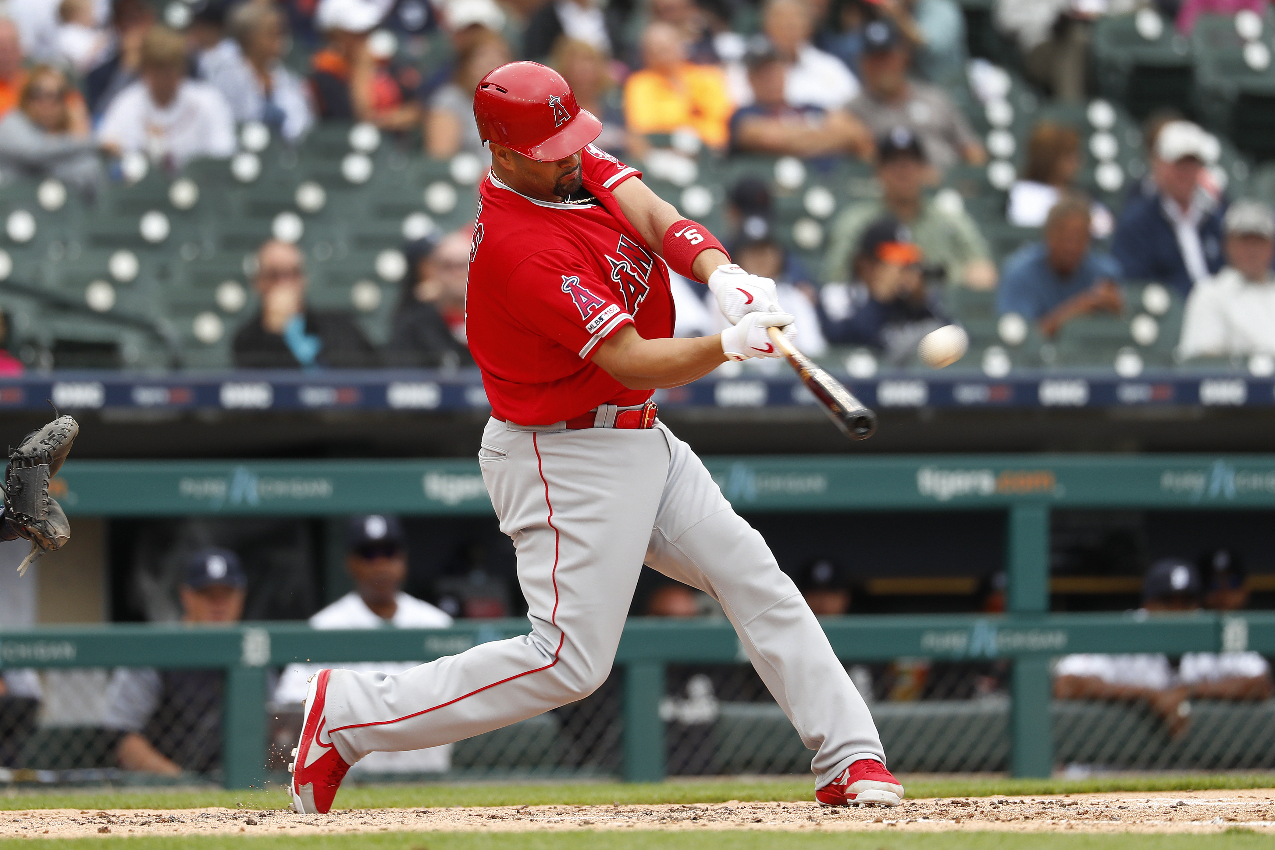 Albert Pujols reaches 2,000 RBIs and Angels rout Tigers 13-0