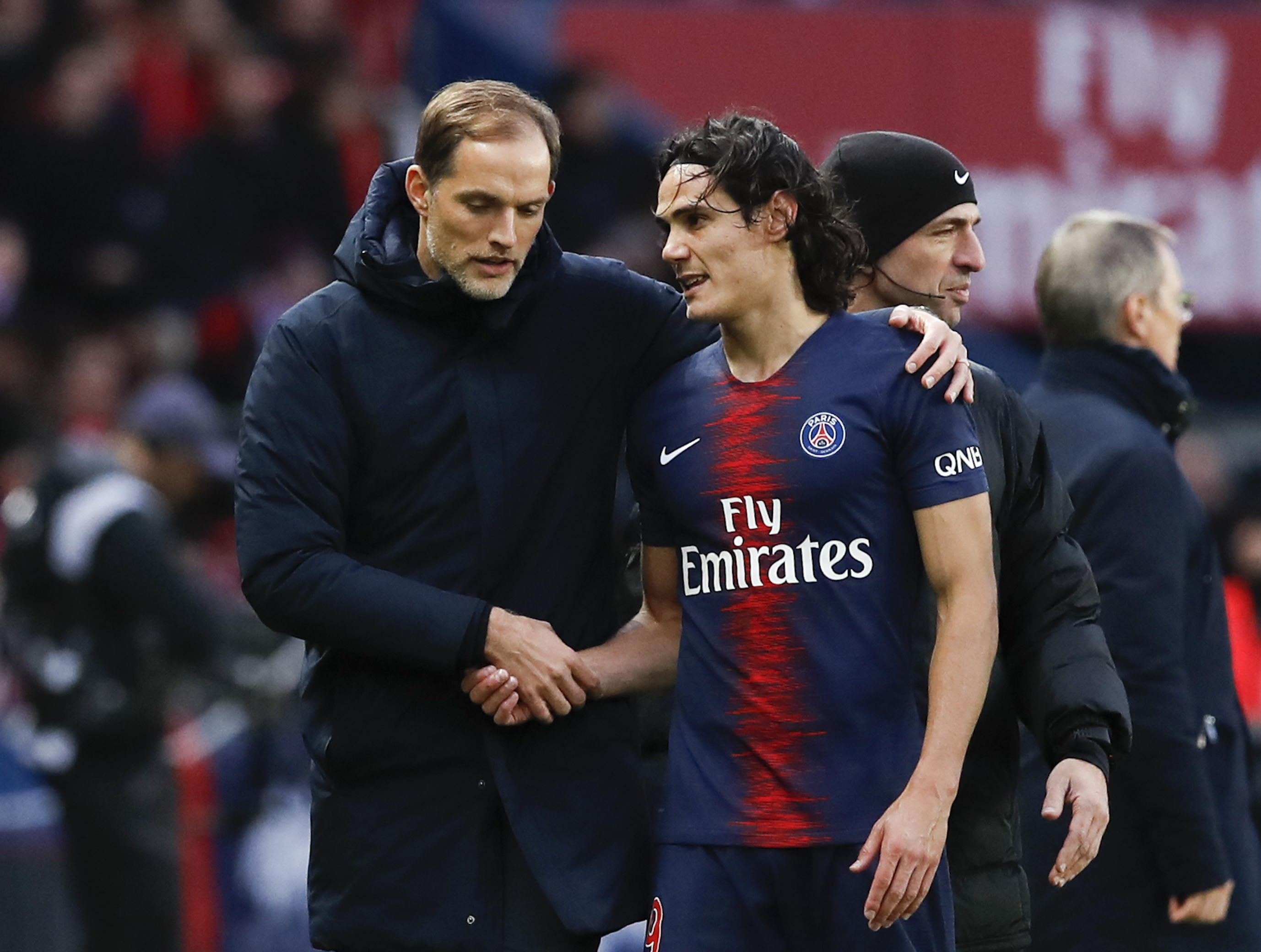 PSG striker Edinson Cavani limps off injured in home win