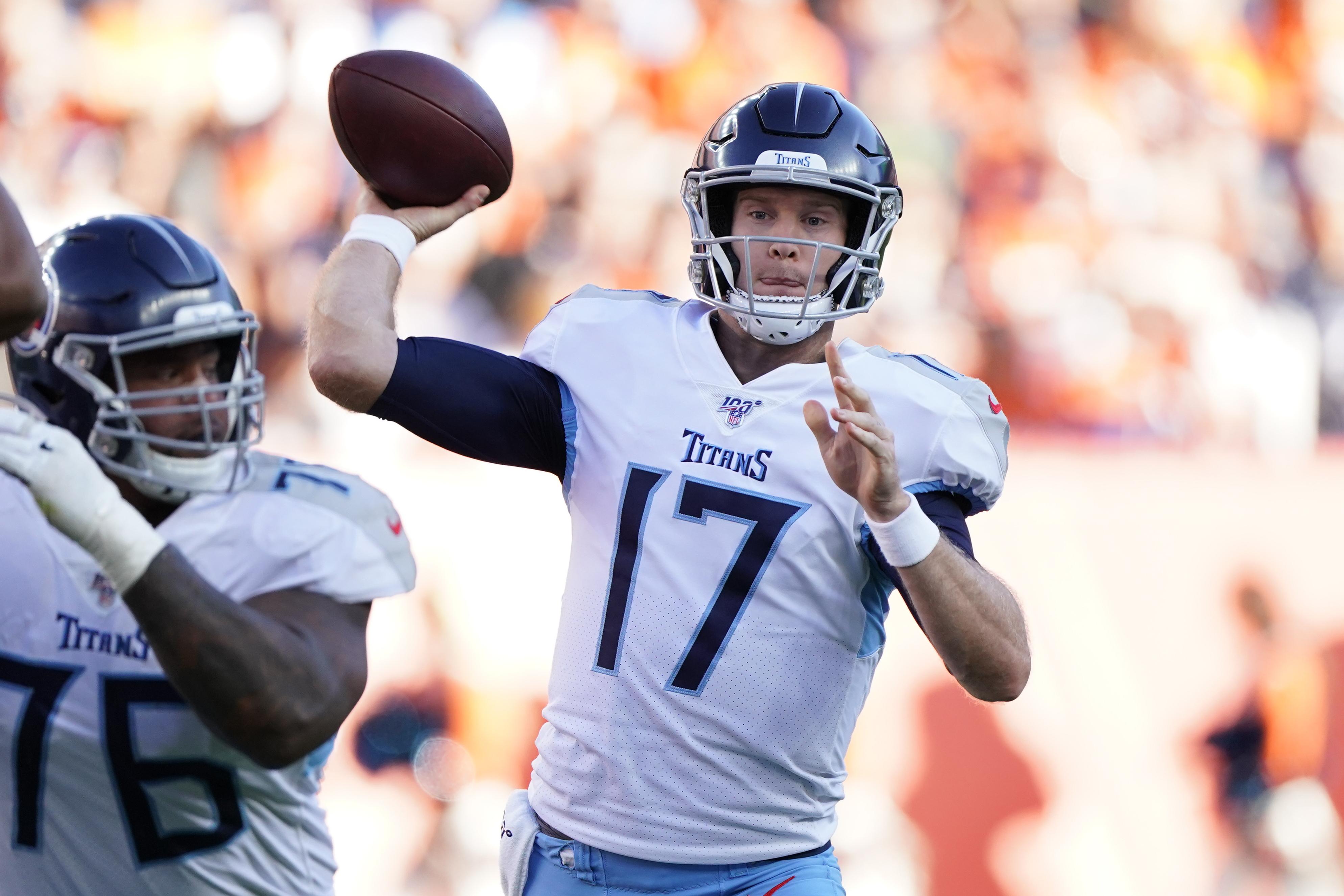 AP source: Titans to start Ryan Tannehill instead of Mariota