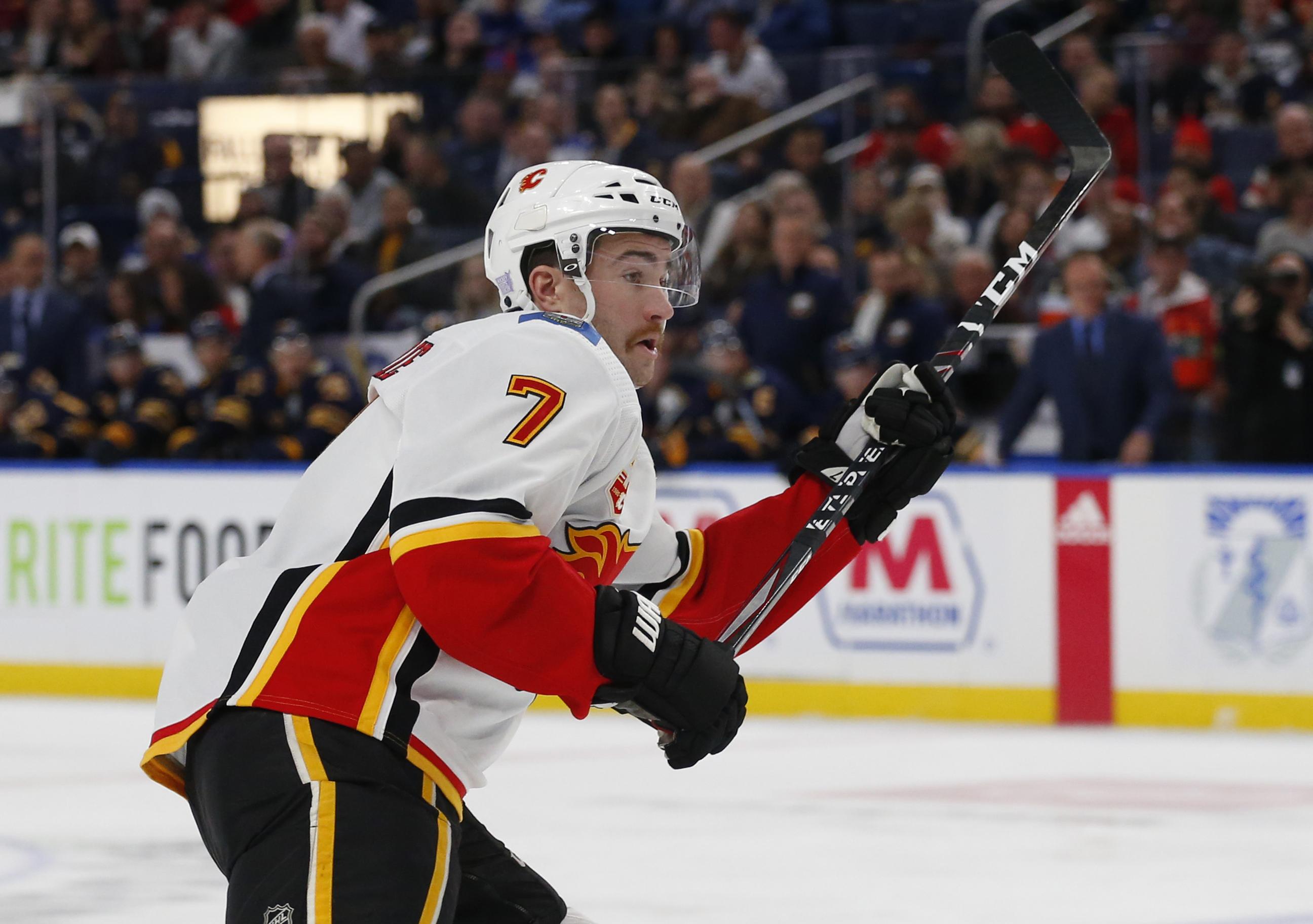 Lindholm scores in OT, Flames beat Sabres 3-2