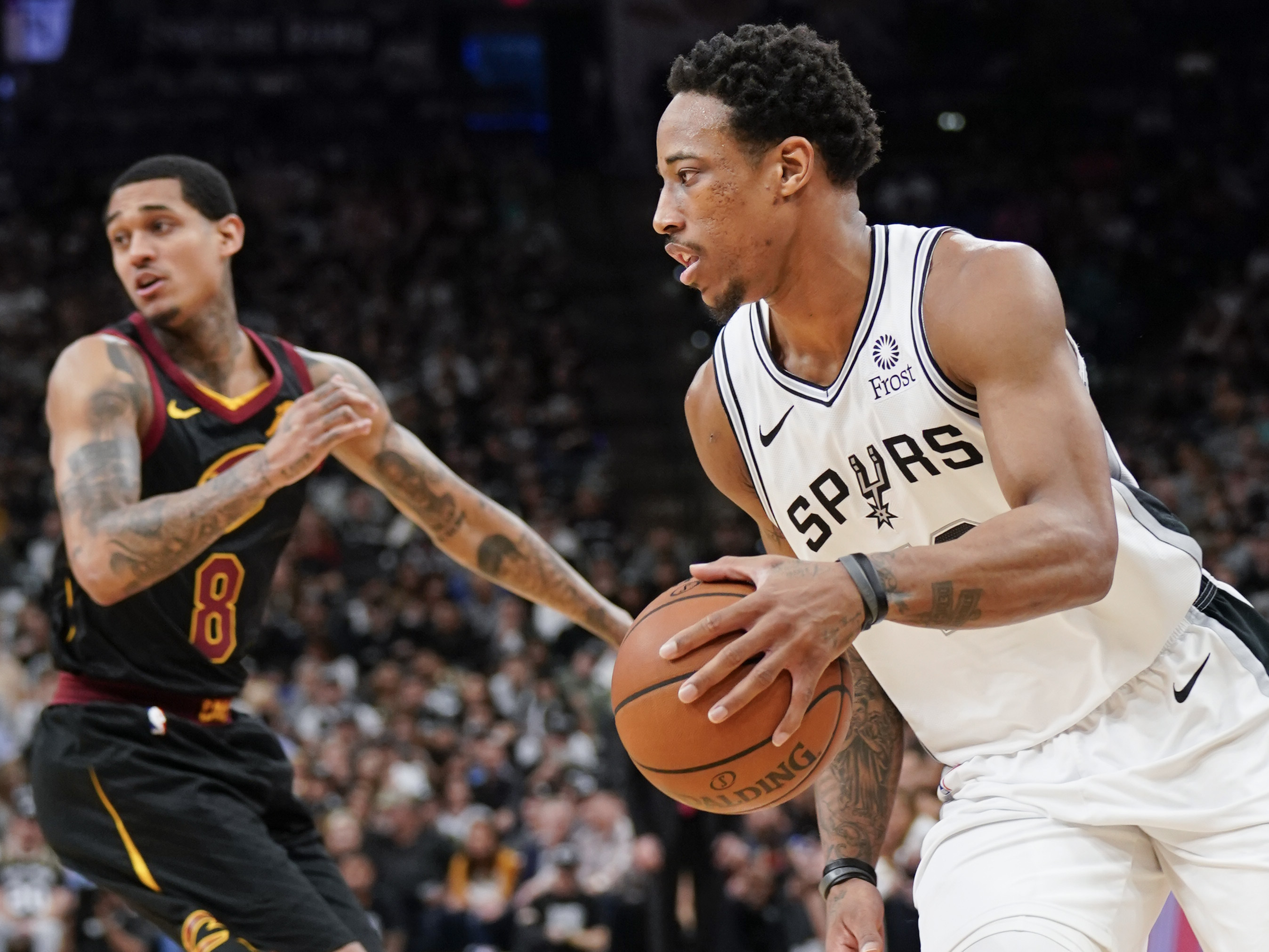 DeRozan leads Spurs past Cavs as team honors Ginobili