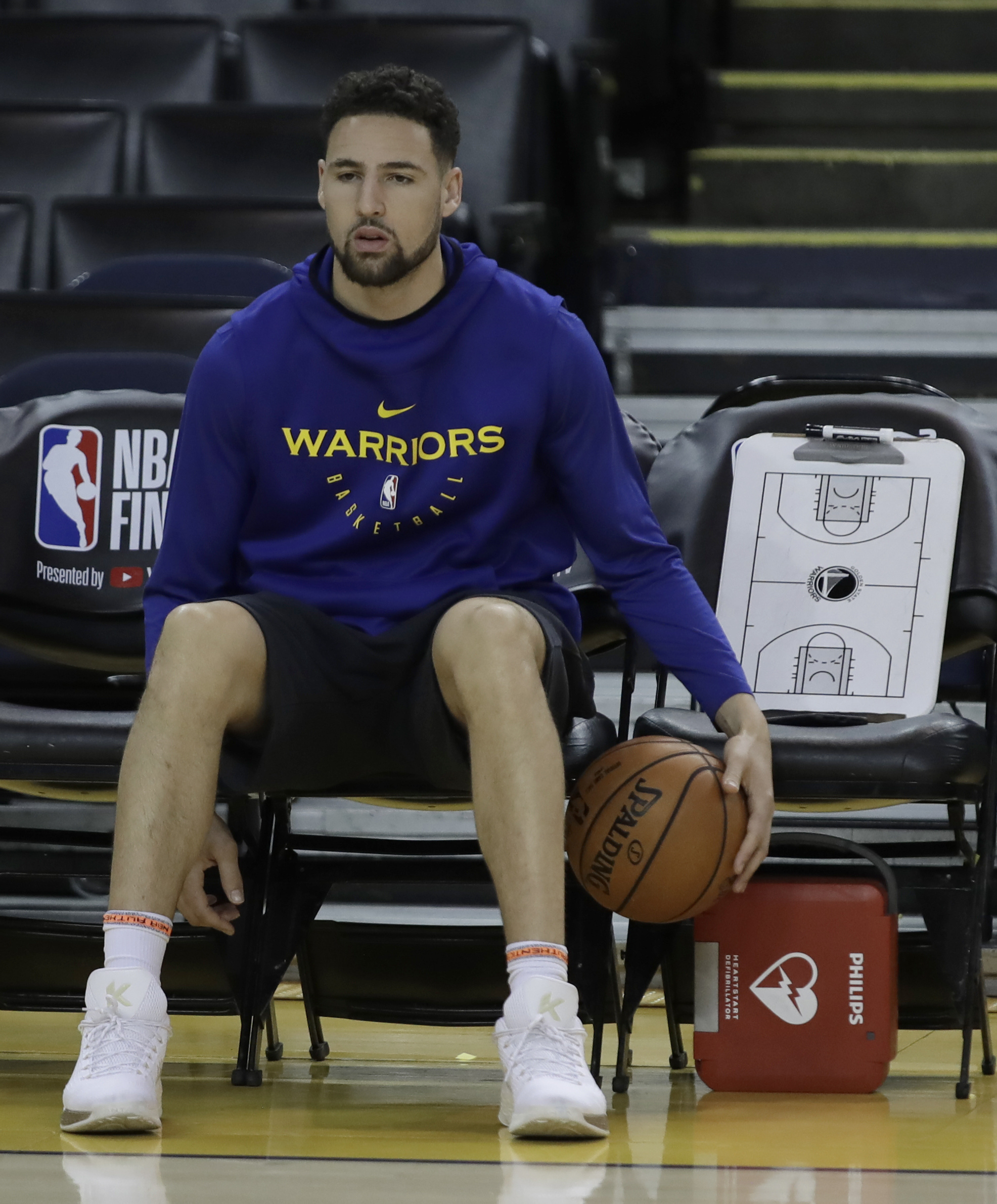 Warriors' Klay Thompson goes through warmups before Game 3