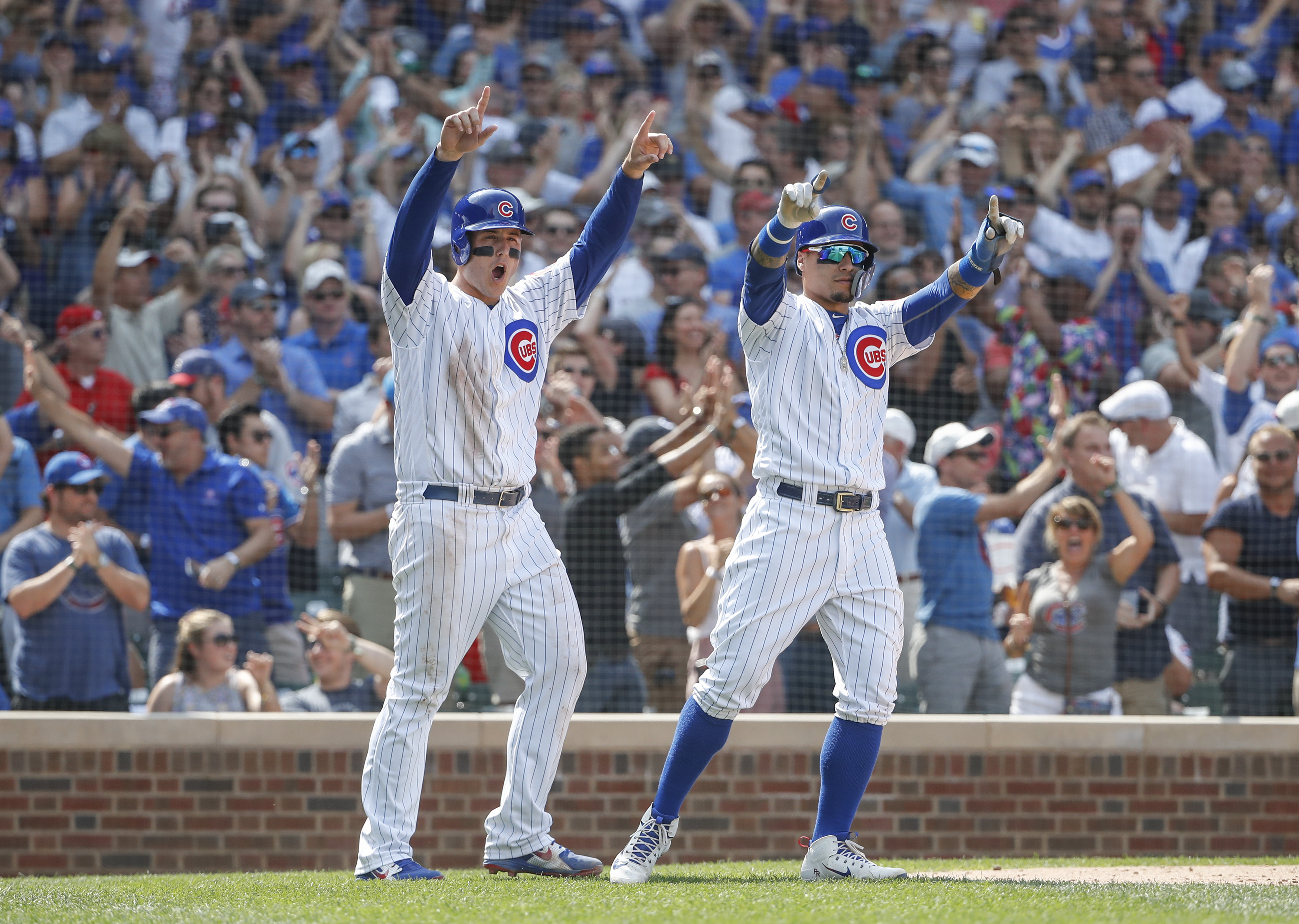 Heyward's single, Rizzo's walk lift Cubs over Nationals 3-2
