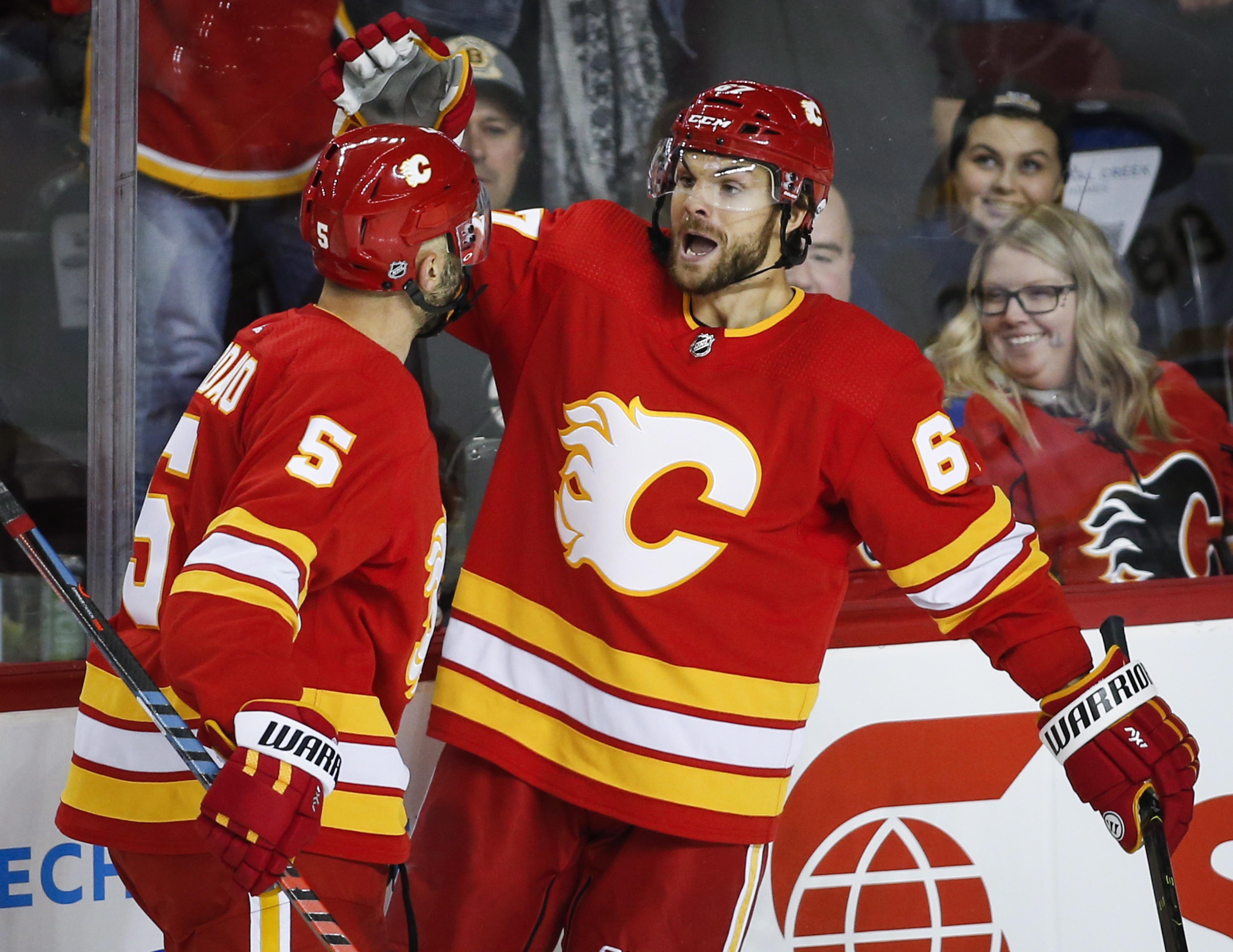 Frolik scores twice, leads Flames past Bruins 5-2