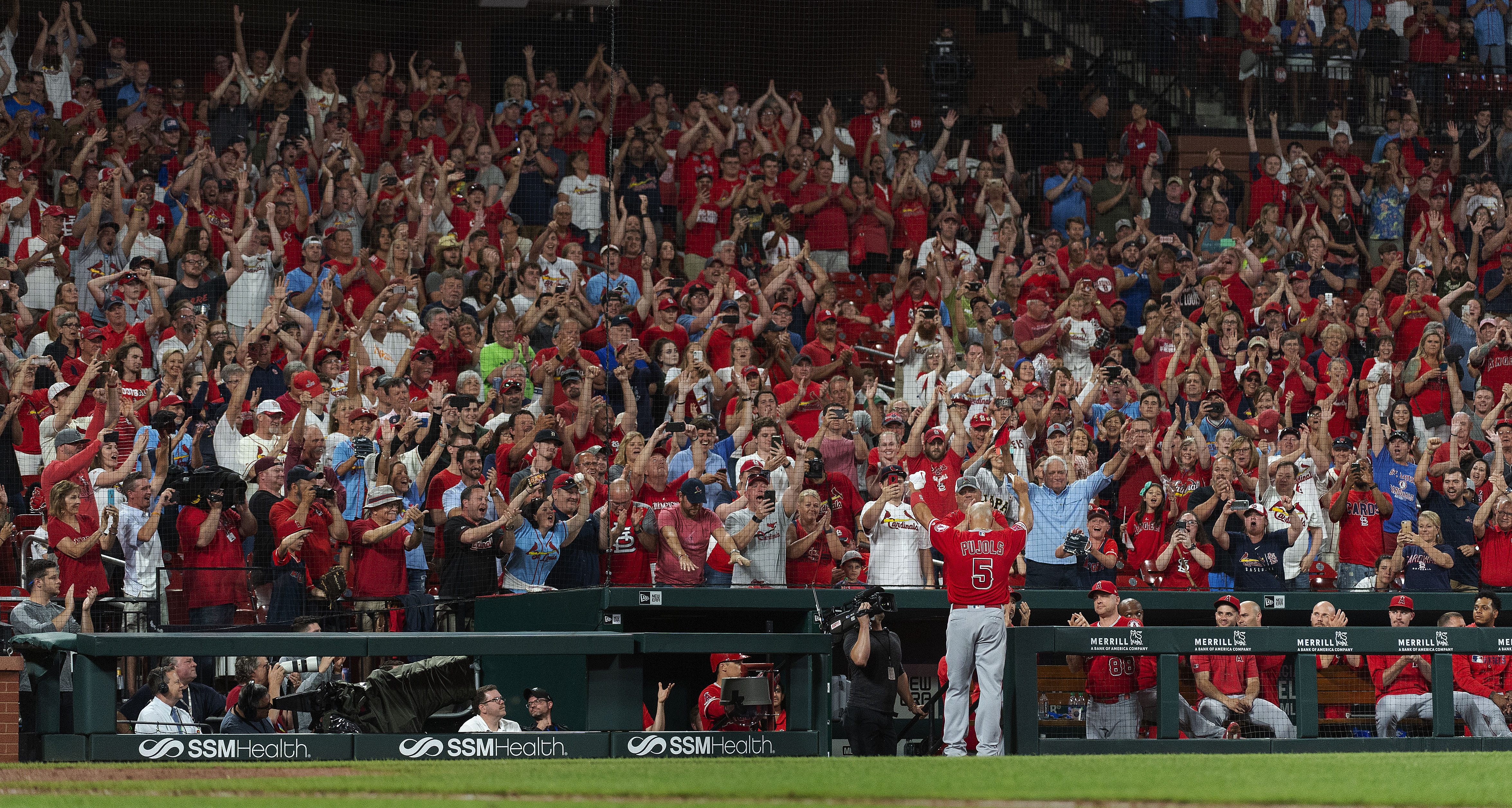 Pujols concludes STL return with 2 hits, Molina jersey swap